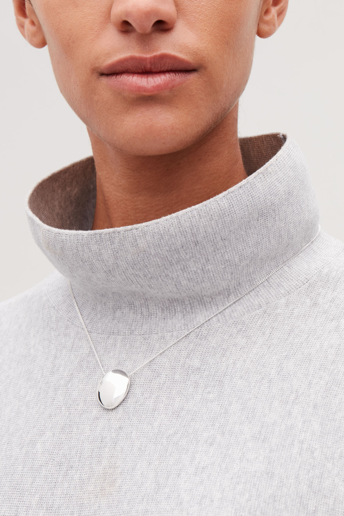 Detailed image of Cos abstract pendant necklace in silver