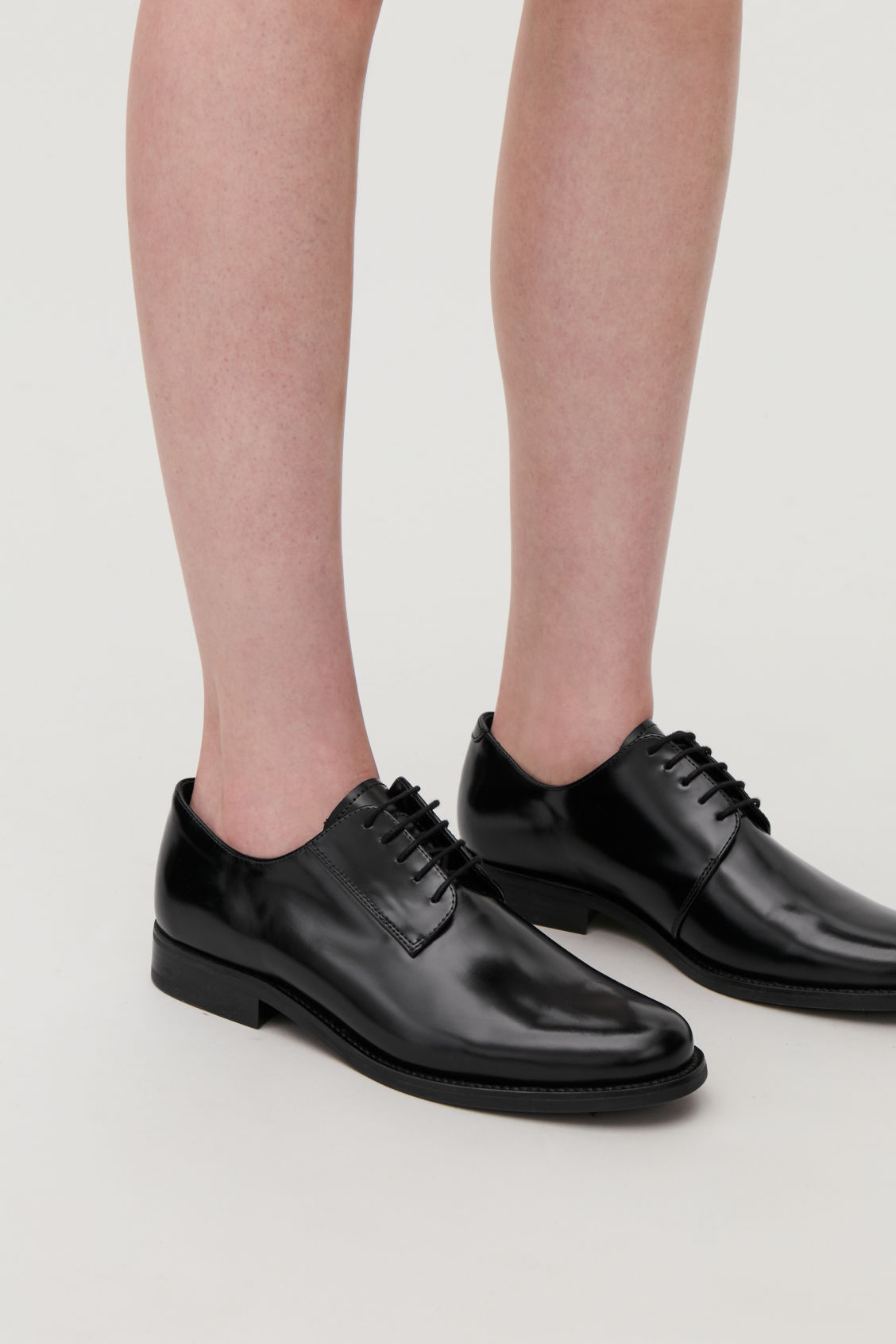 Detailed image of Cos round-toe leather oxford shoes in black