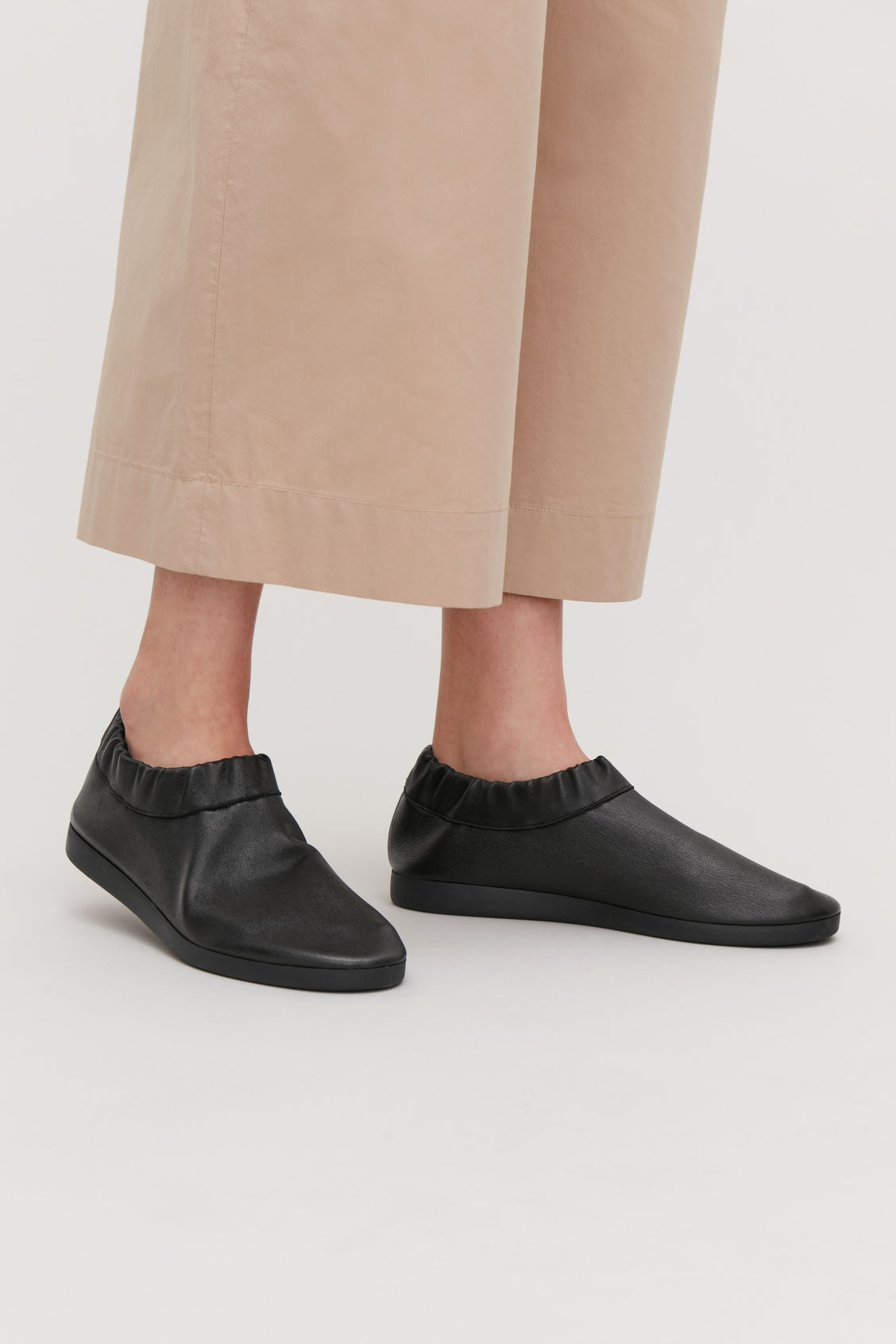 Detailed image of Cos slip-on leather sneakers in black