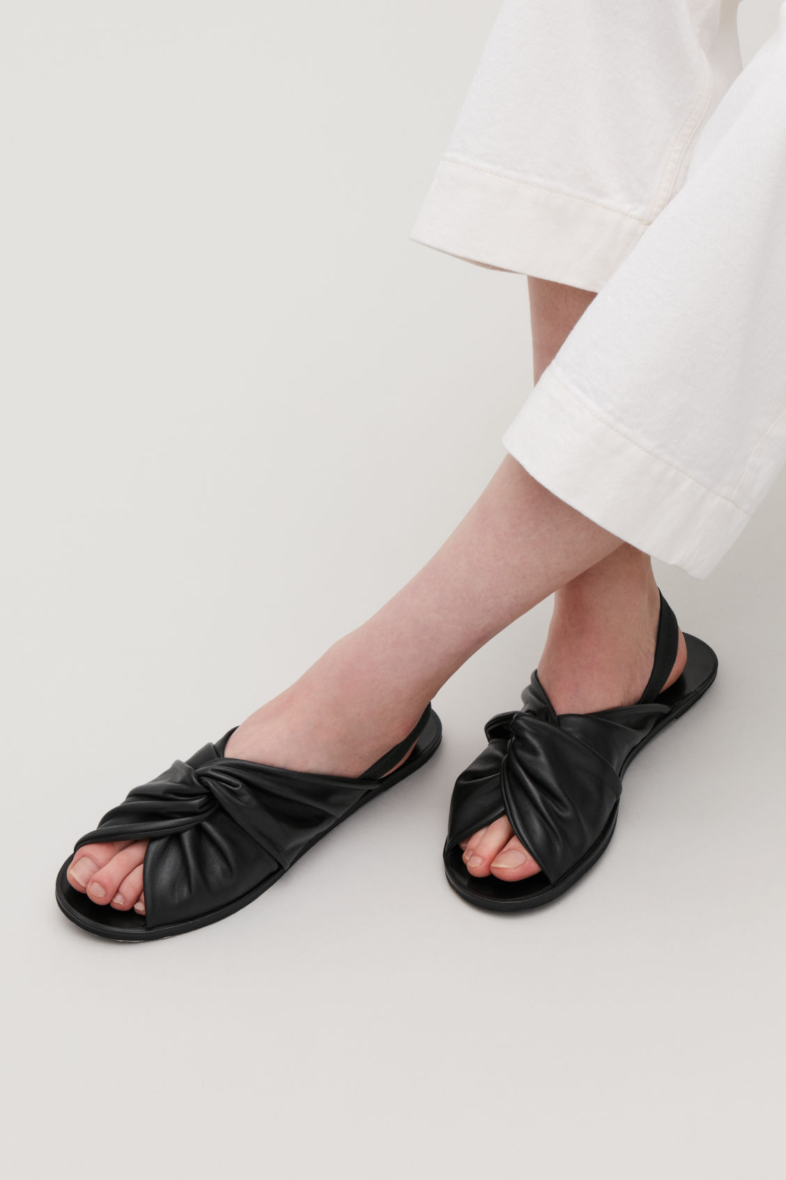 Detailed image of Cos knotted leather sandals in black