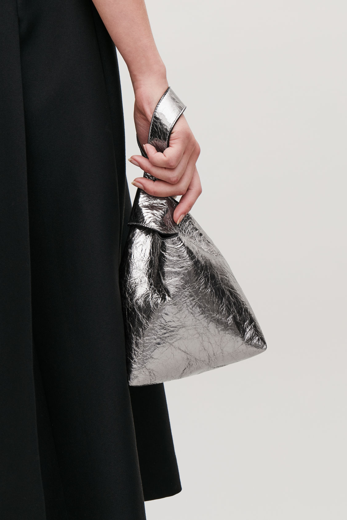 Detailed image of Cos leather wristlet bag in silver