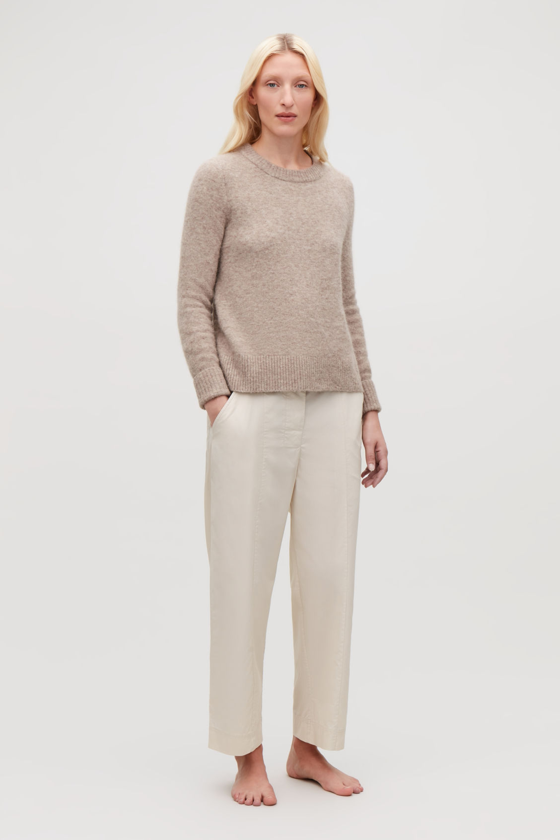Detailed image of Cos trousers with folded waistband in beige