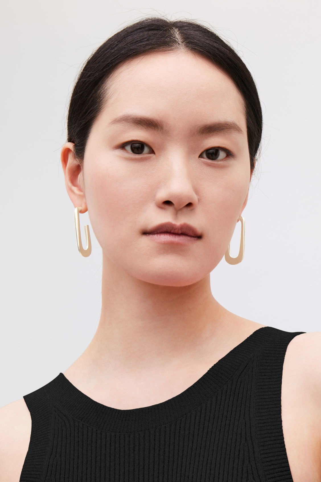 Detailed image of Cos gold-plated hoop earrings  in gold