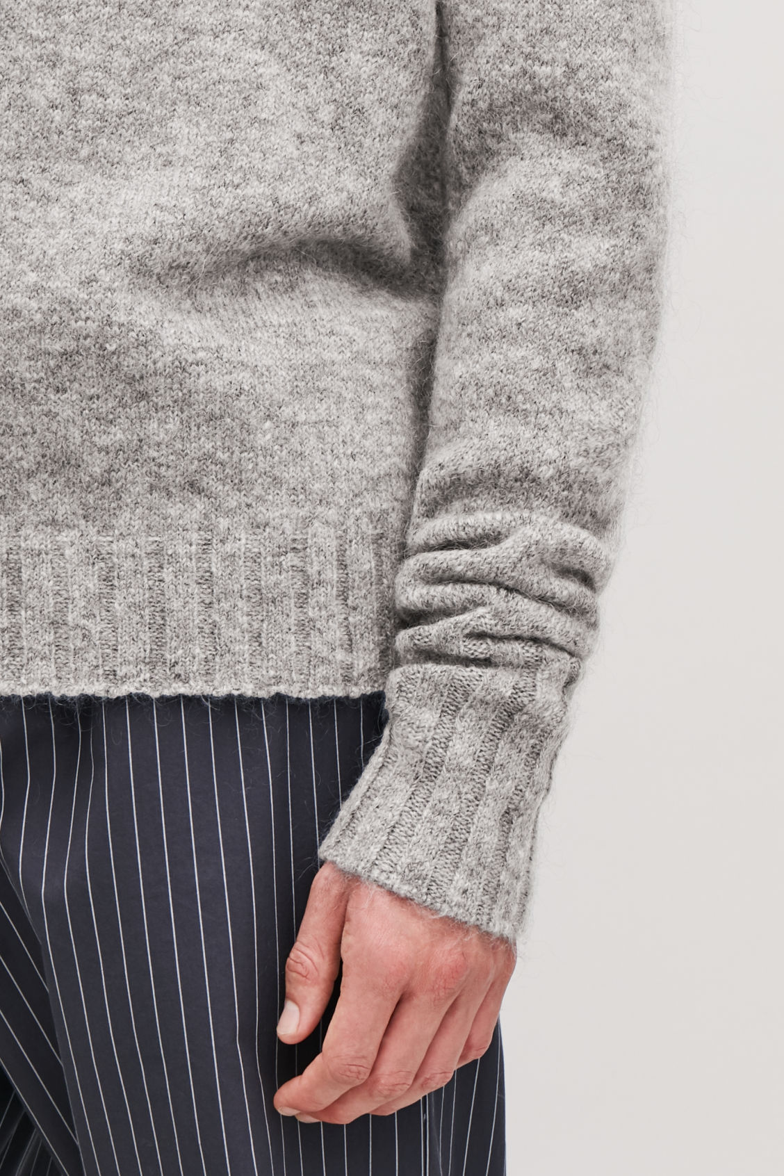 Detailed image of Cos chunky roll-neck jumper in grey