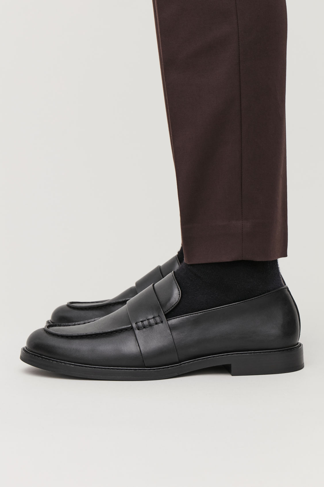 Detailed image of Cos leather penny loafers in black
