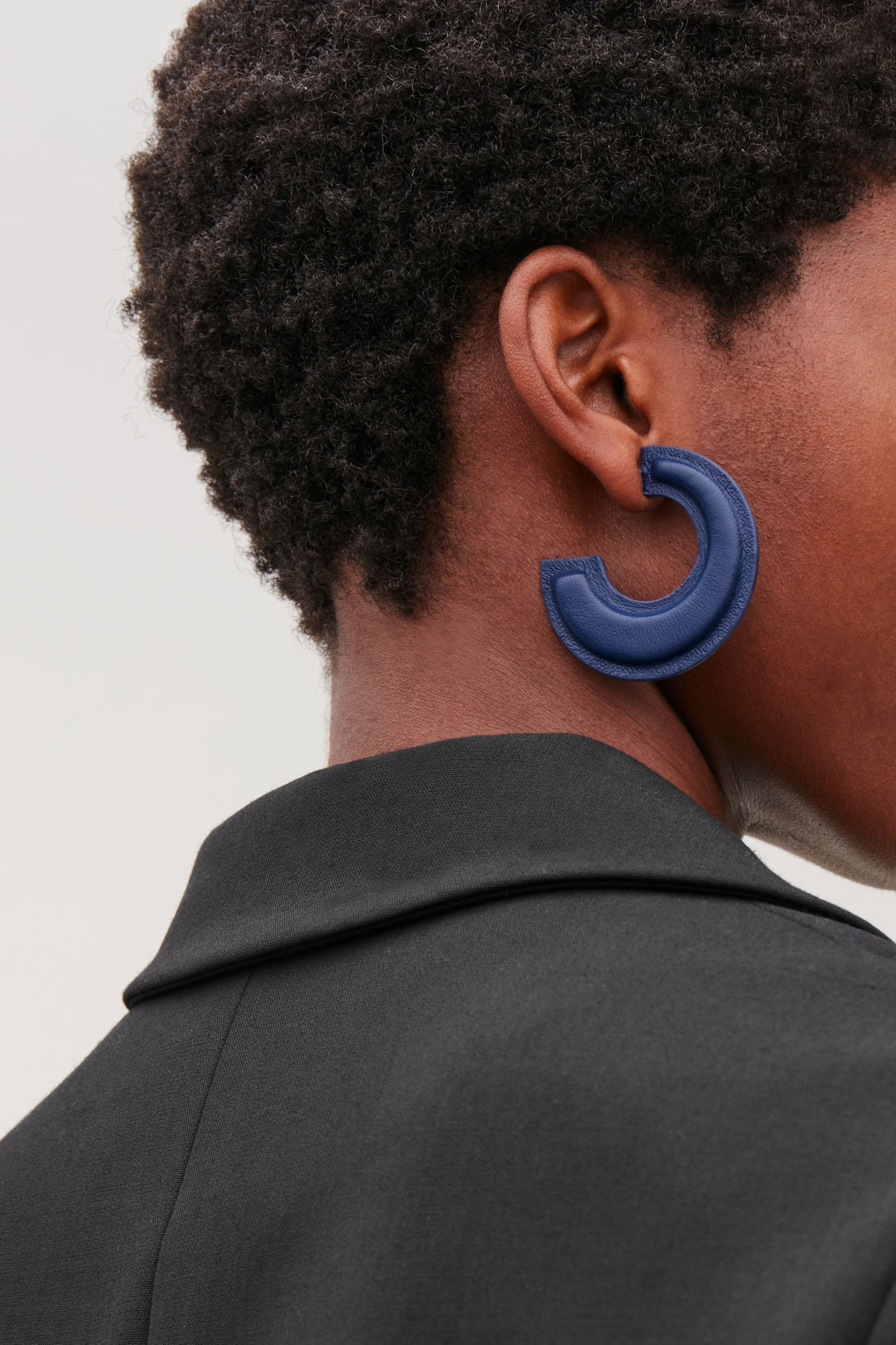 Detailed image of Cos padded two-tone leather hoops in blue