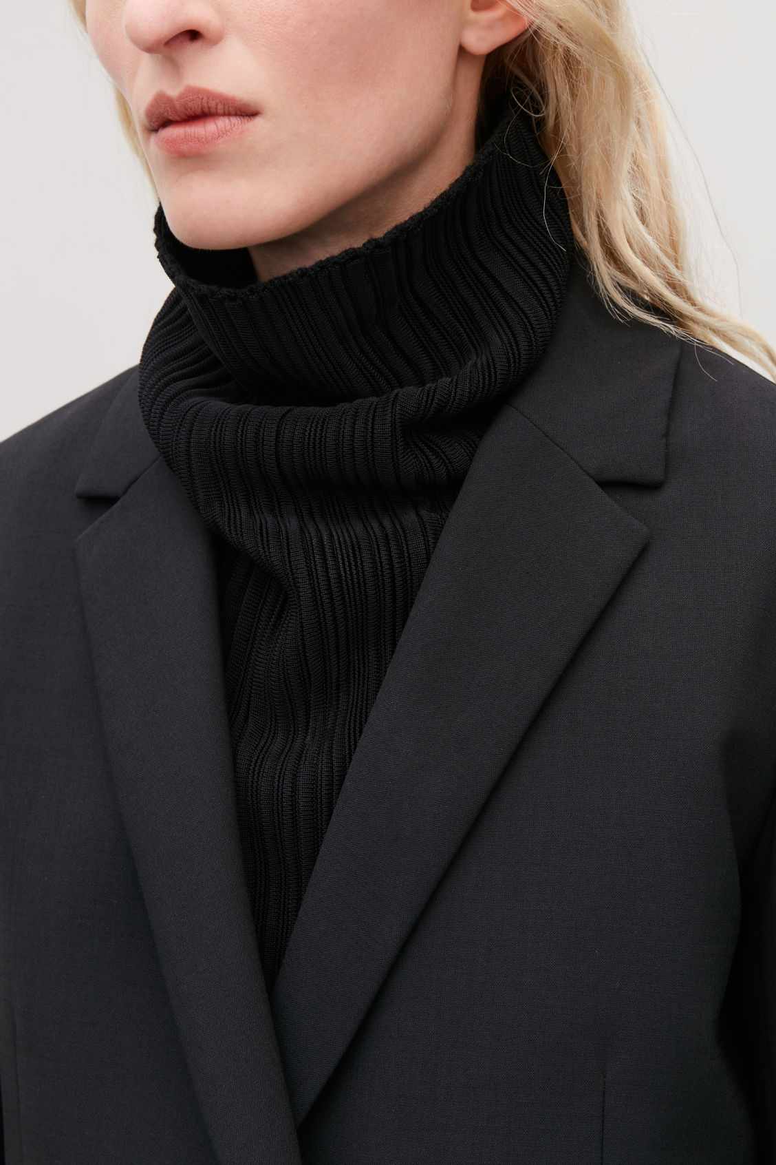 Detailed image of Cos high rippled-wool mock neck in black