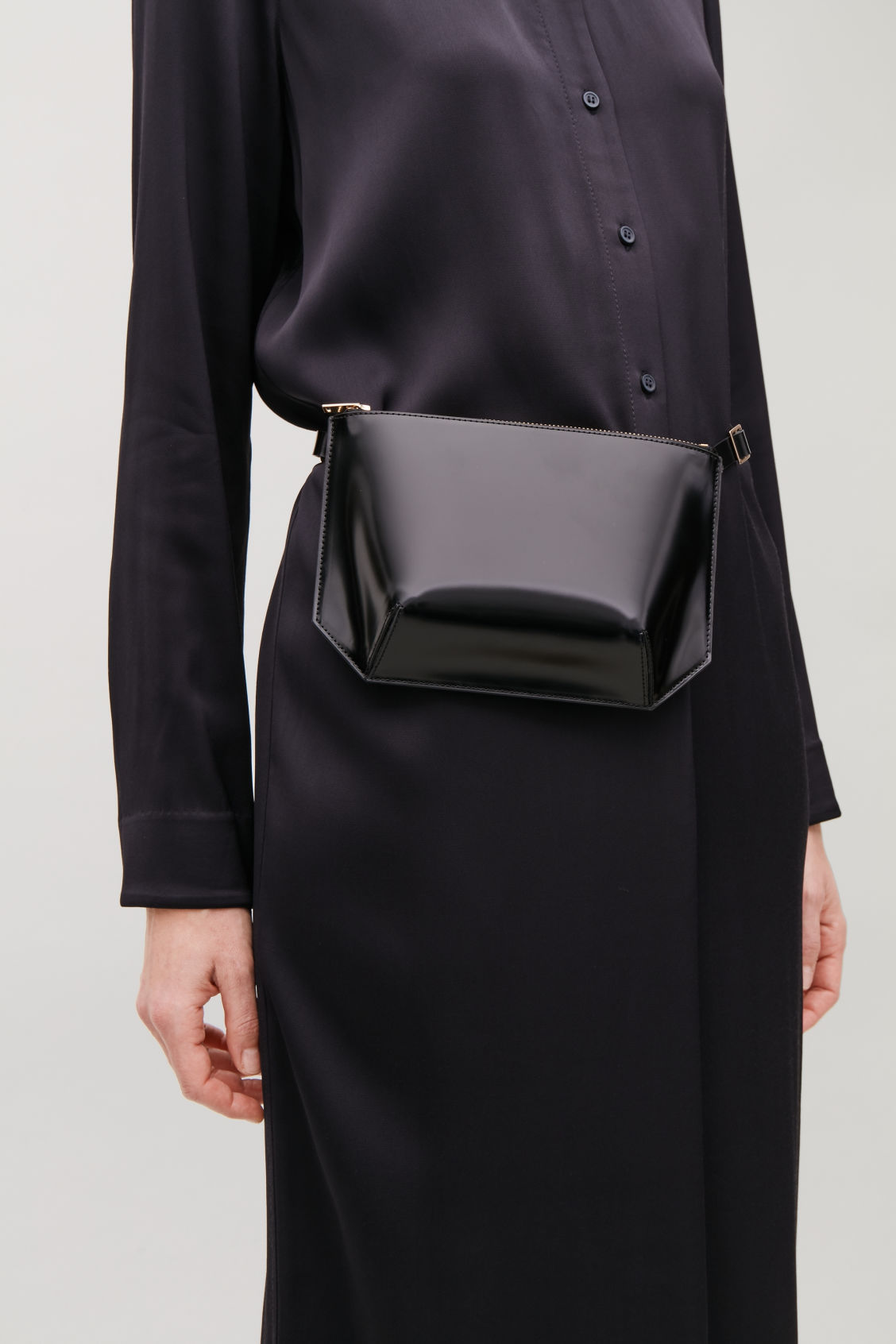 Detailed image of Cos multifunctional leather bag in black