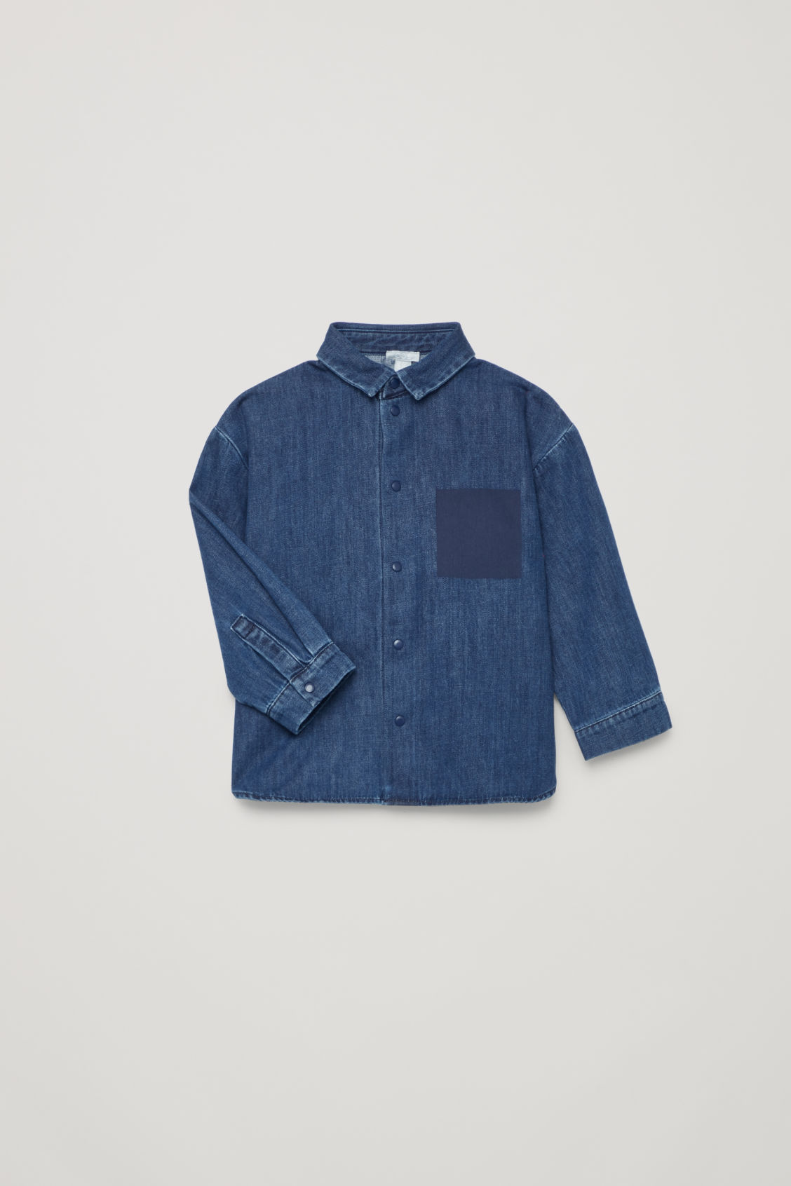 Detailed image of Cos denim shirt with fake pocket in blue