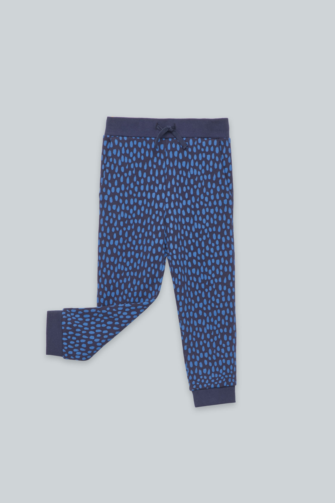 Detailed image of Cos printed jersey trousers in blue