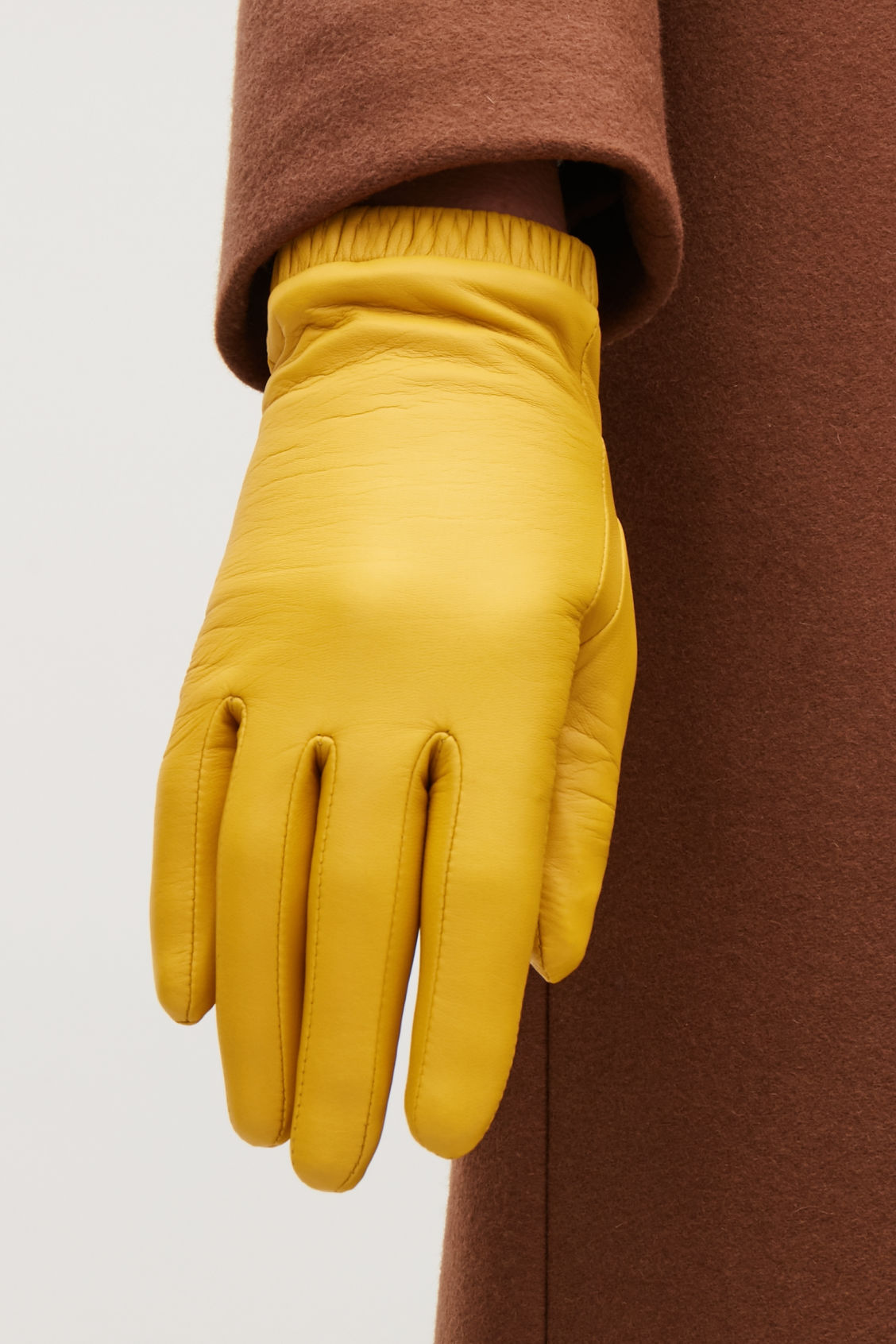 Detailed image of Cos gathered leather gloves in yellow