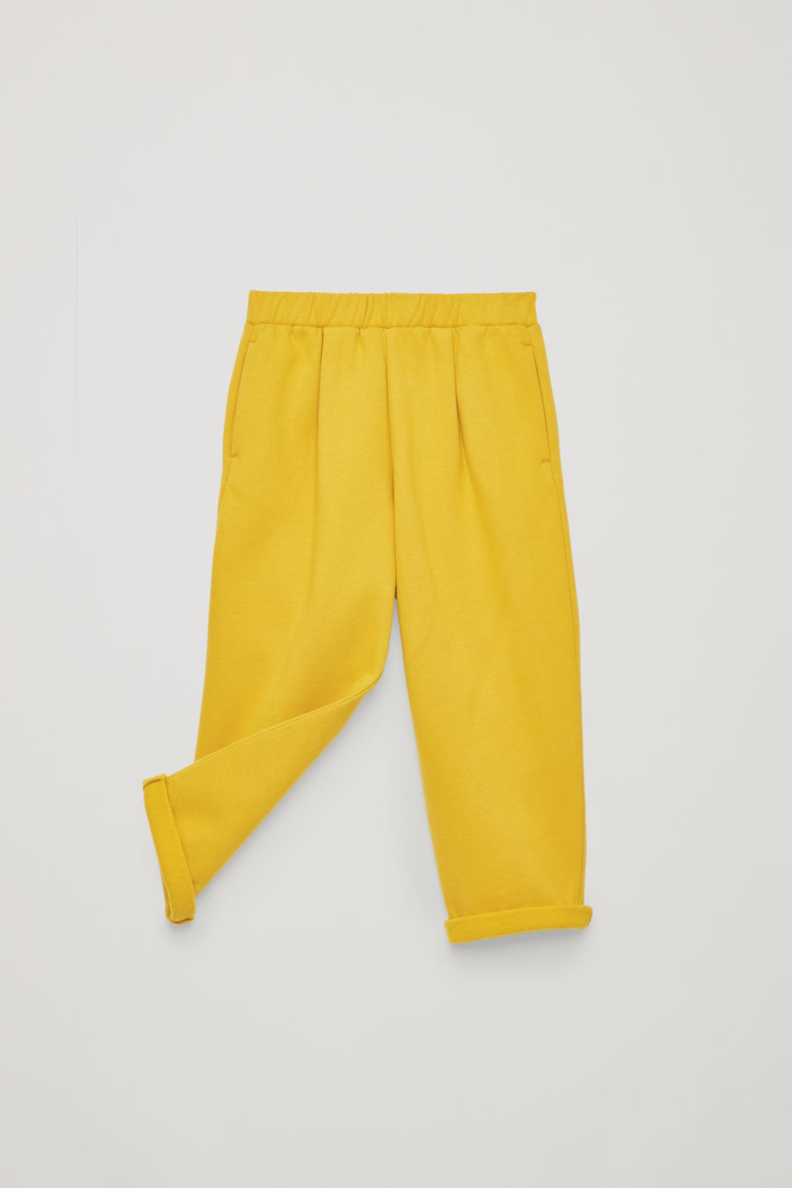 Detailed image of Cos relaxed jersey trousers in yellow