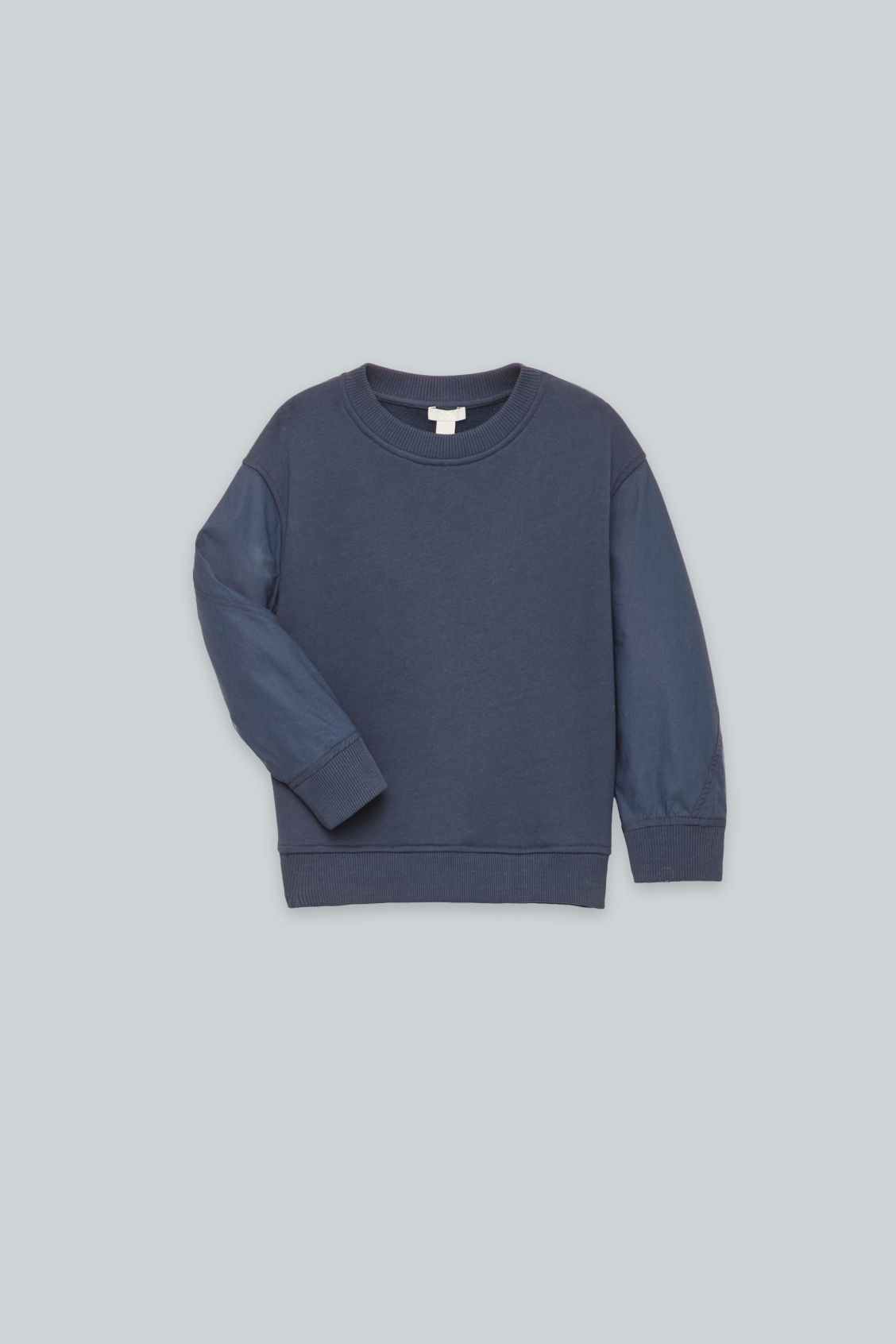 Detailed image of Cos woven-jersey mix jumper in blue