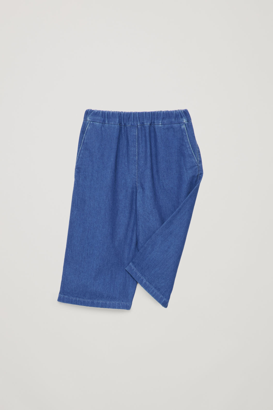 Detailed image of Cos wide-leg trousers in blue
