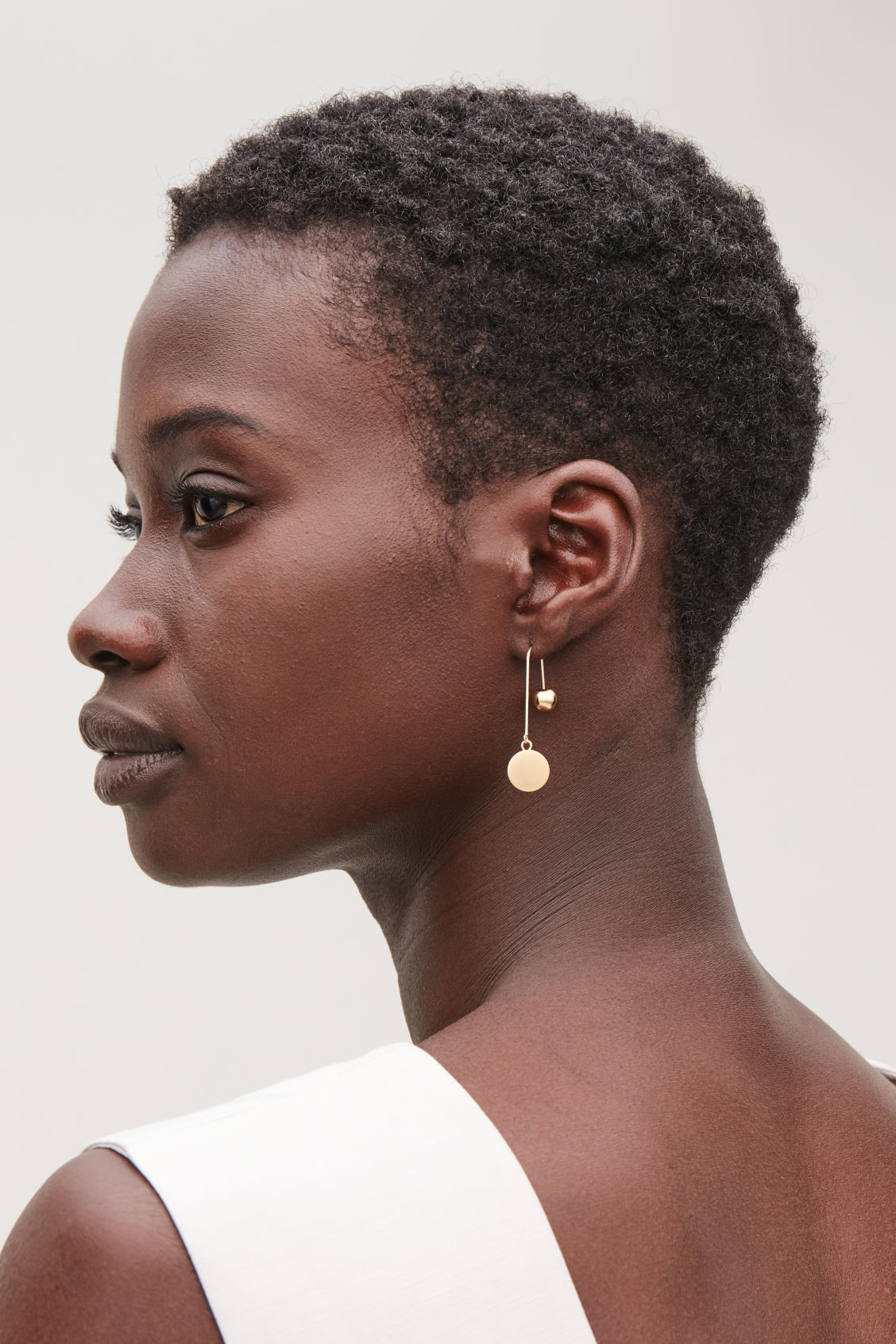Detailed image of Cos ball and disc drop earrings in gold