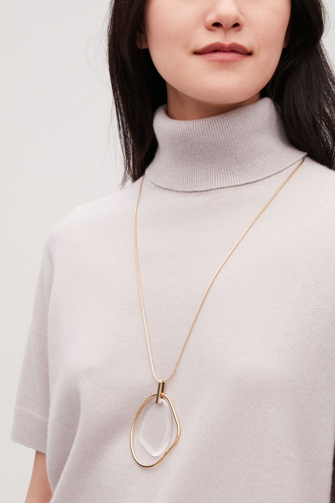 Detailed image of Cos long glass pendant necklace  in gold