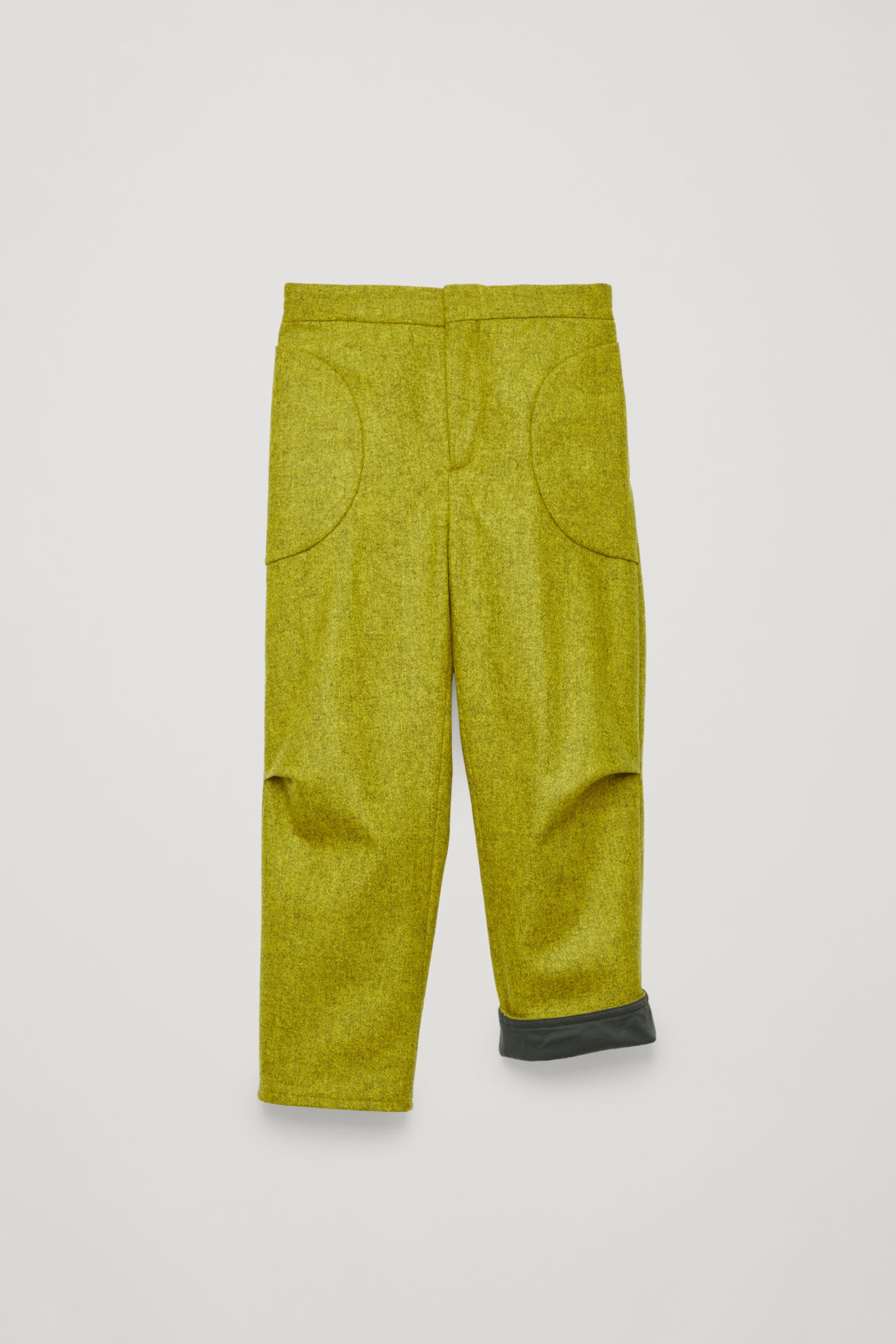 Detailed image of Cos trousers with pleated pockets in yellow