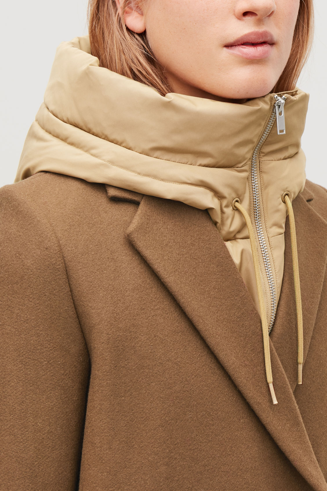Detailed image of Cos padded hood in beige