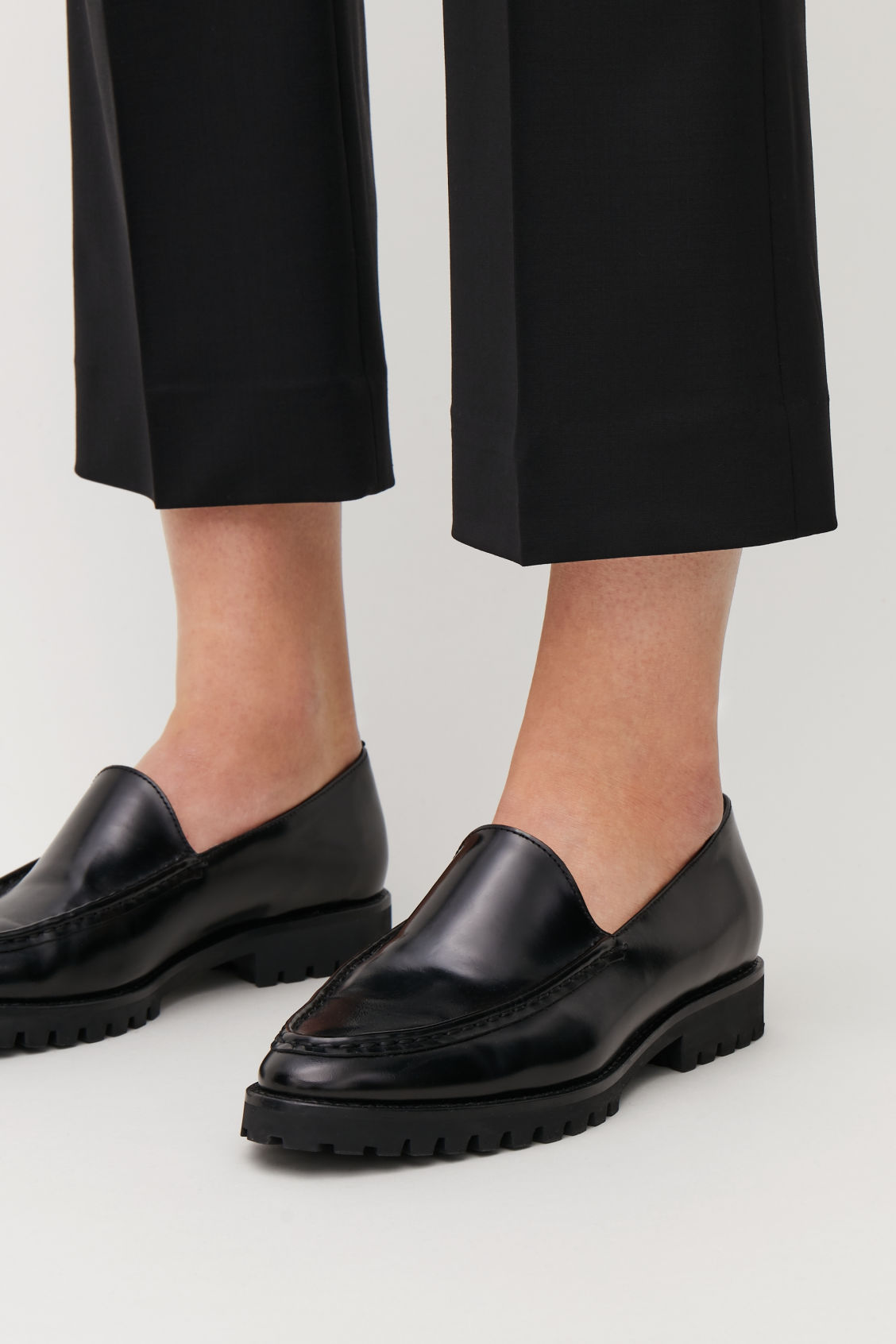Detailed image of Cos ridged-sole leather loafers in black