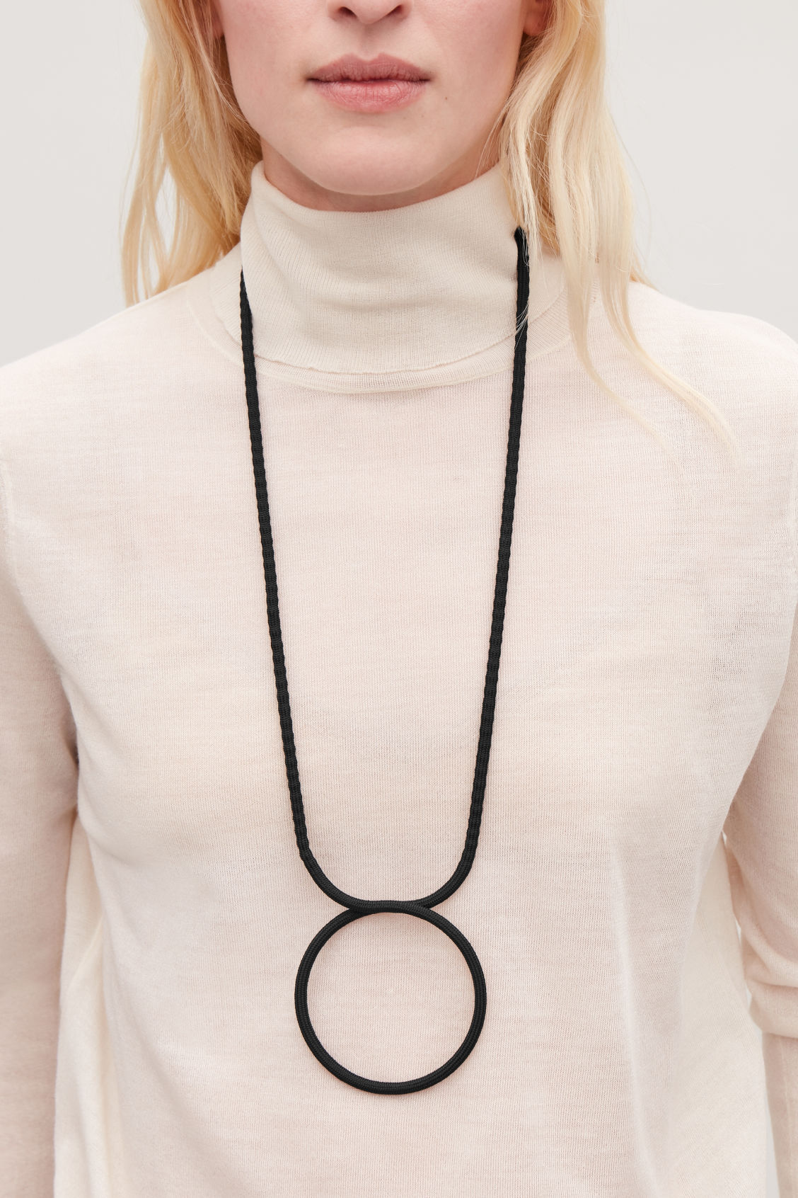 Detailed image of Cos long fabric-ring necklace in black