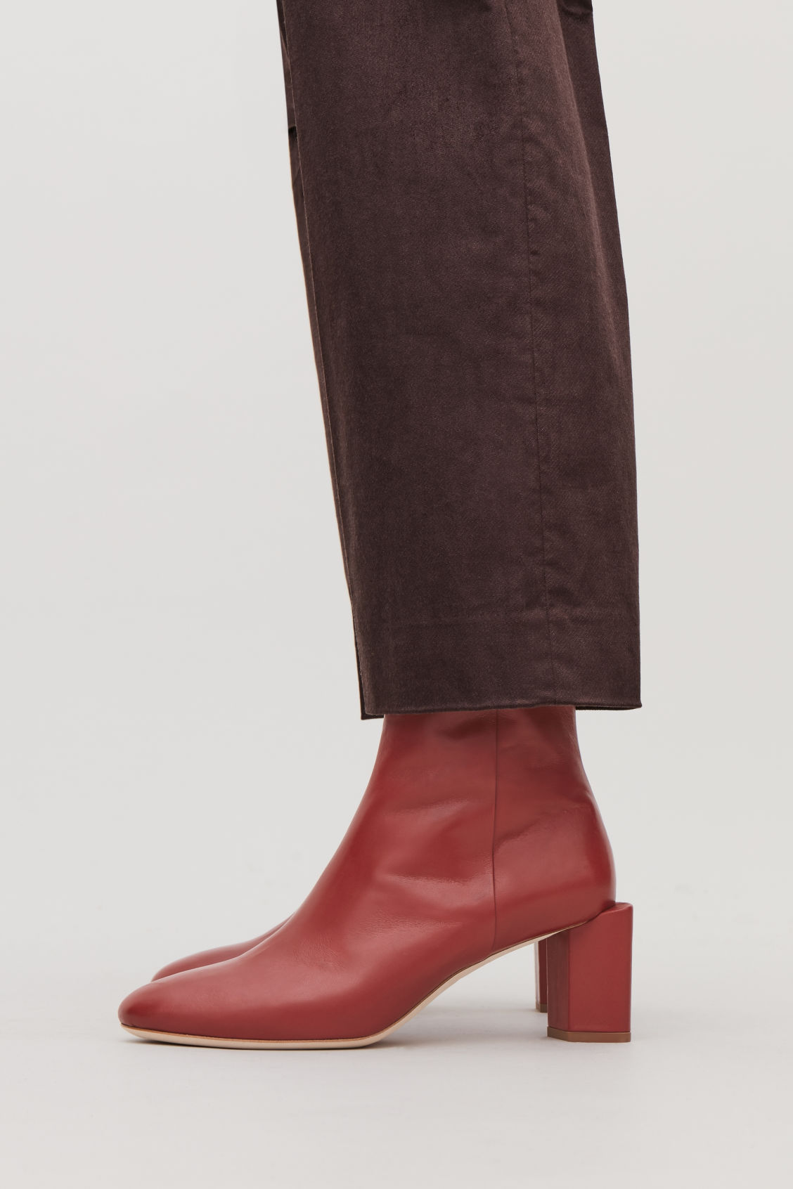 Detailed image of Cos sculptural leather ankle boots in red