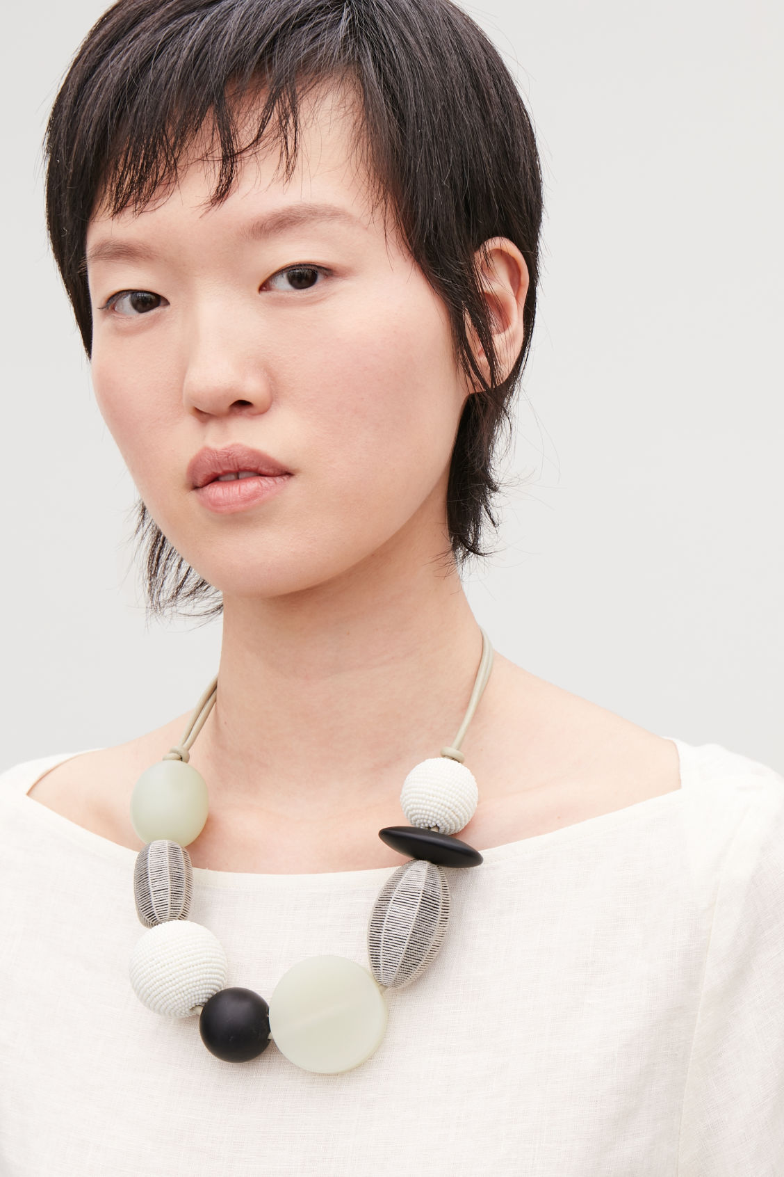 Detailed image of Cos mix-material long necklace in beige