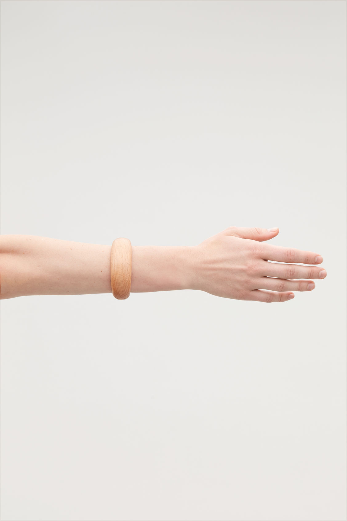 Detailed image of Cos wooden bangle in beige
