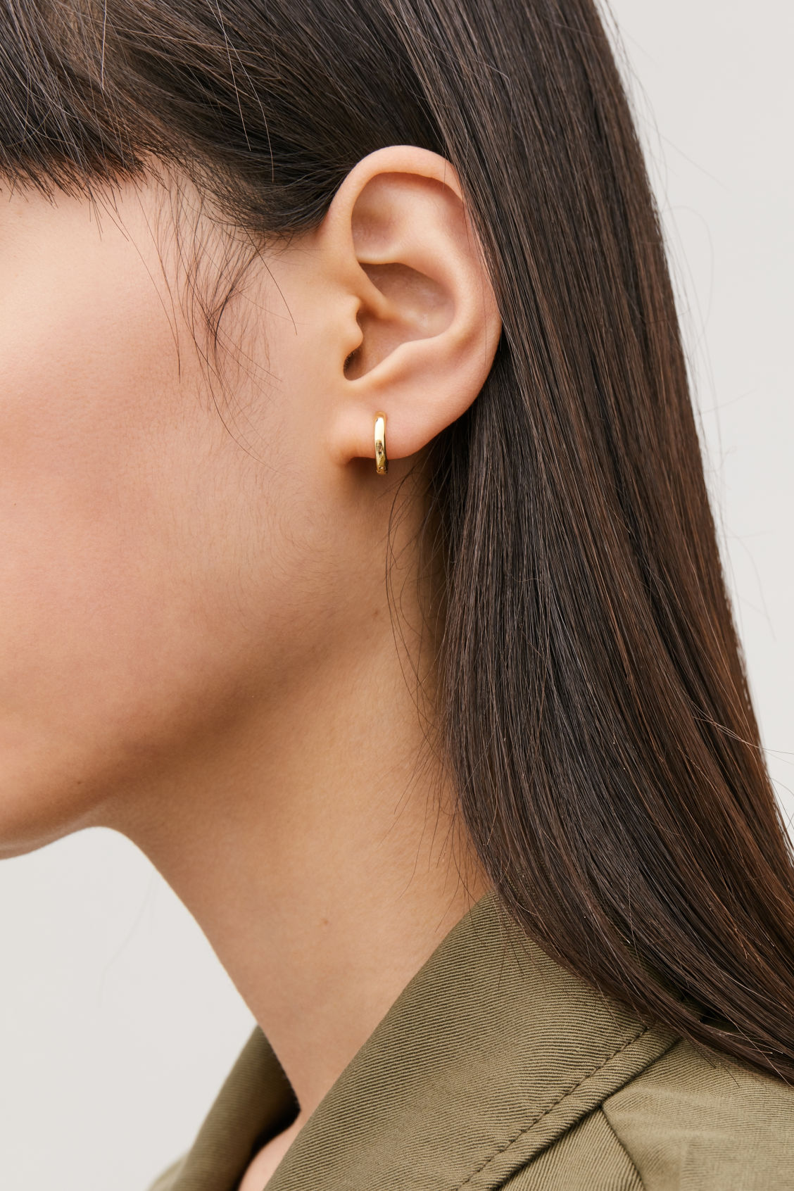 Detailed image of Cos gold-plated micro hoop earrings in gold
