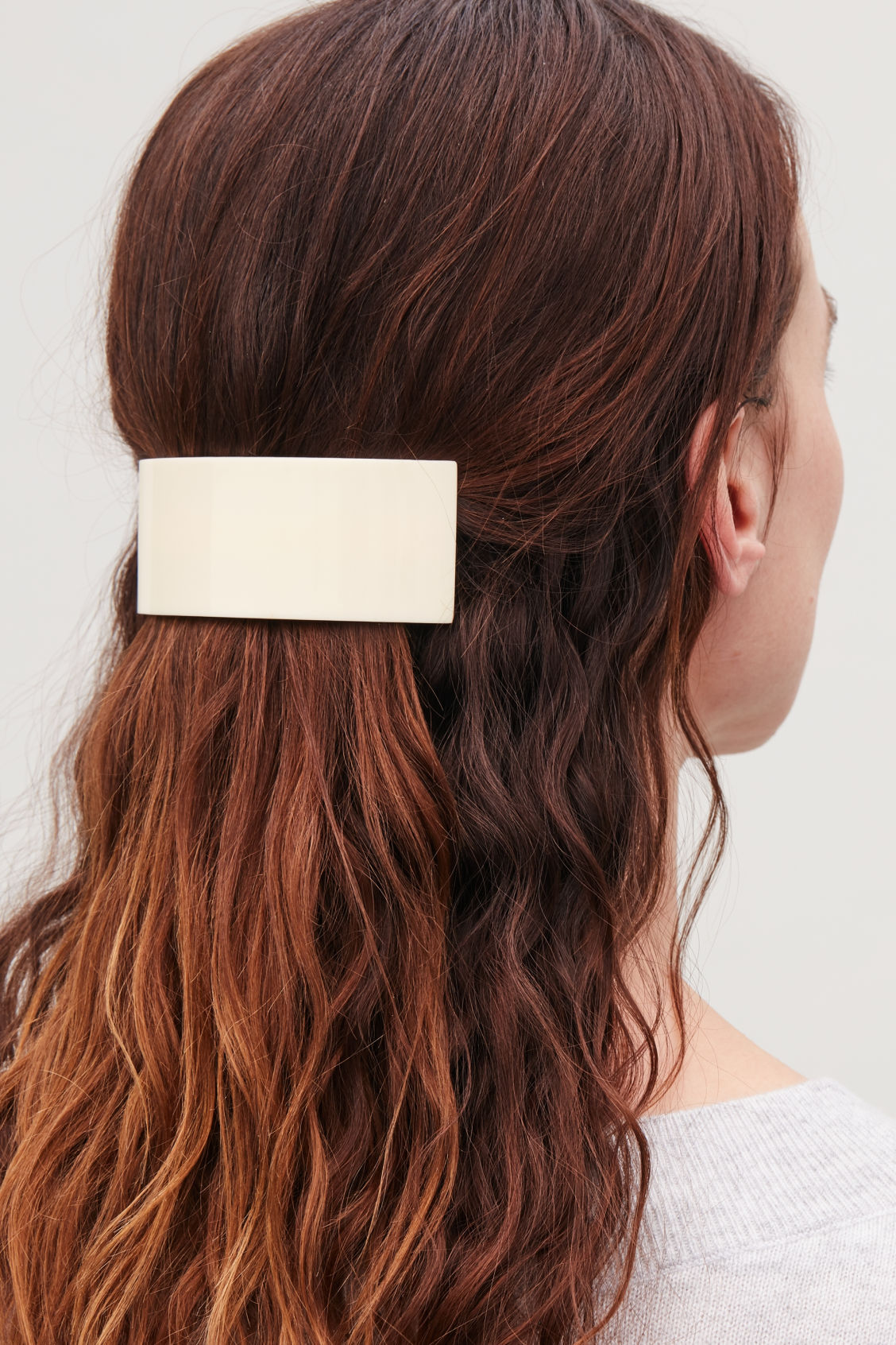 Detailed image of Cos curved hair clip in white