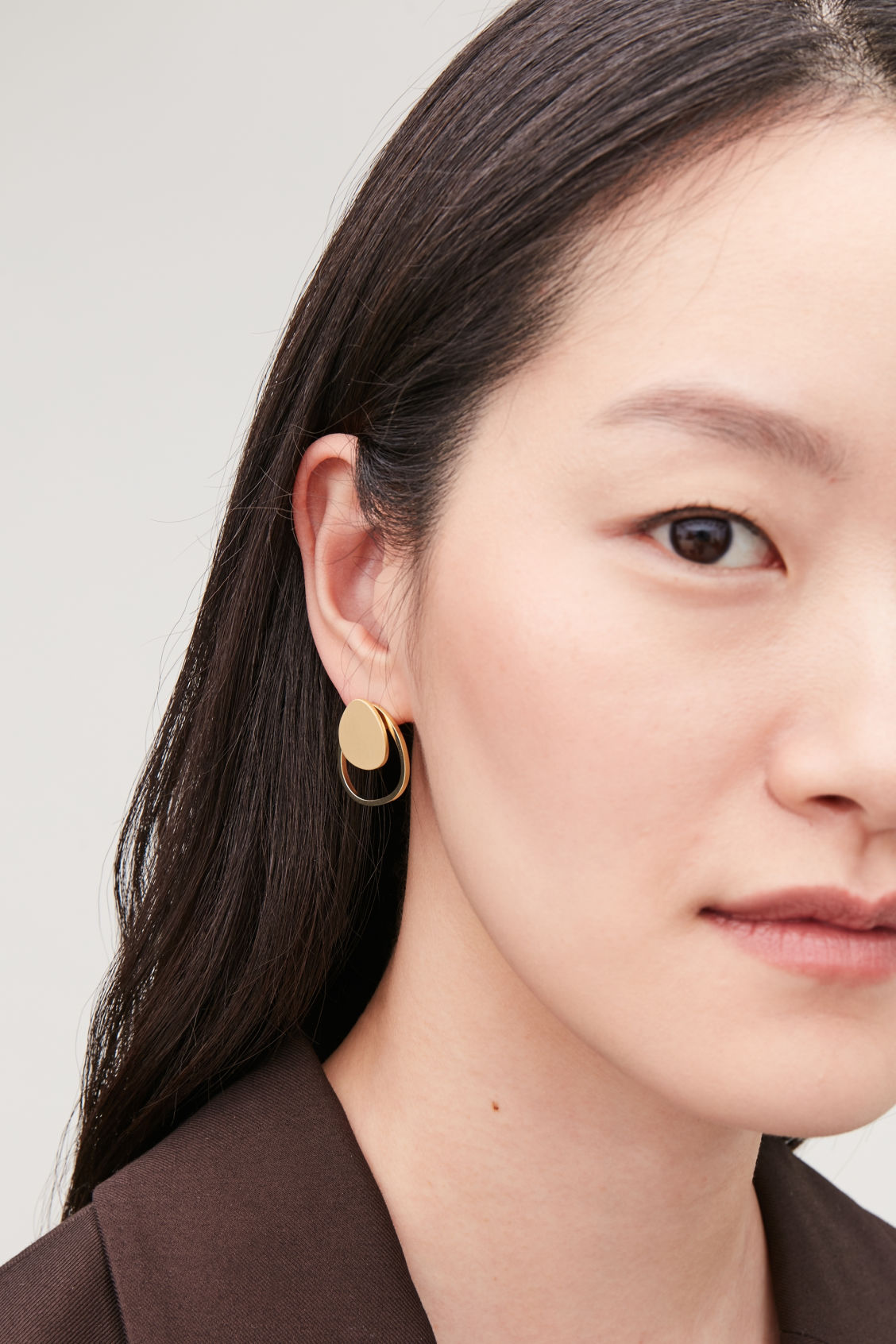 Detailed image of Cos rounded-shape stud earrings  in gold