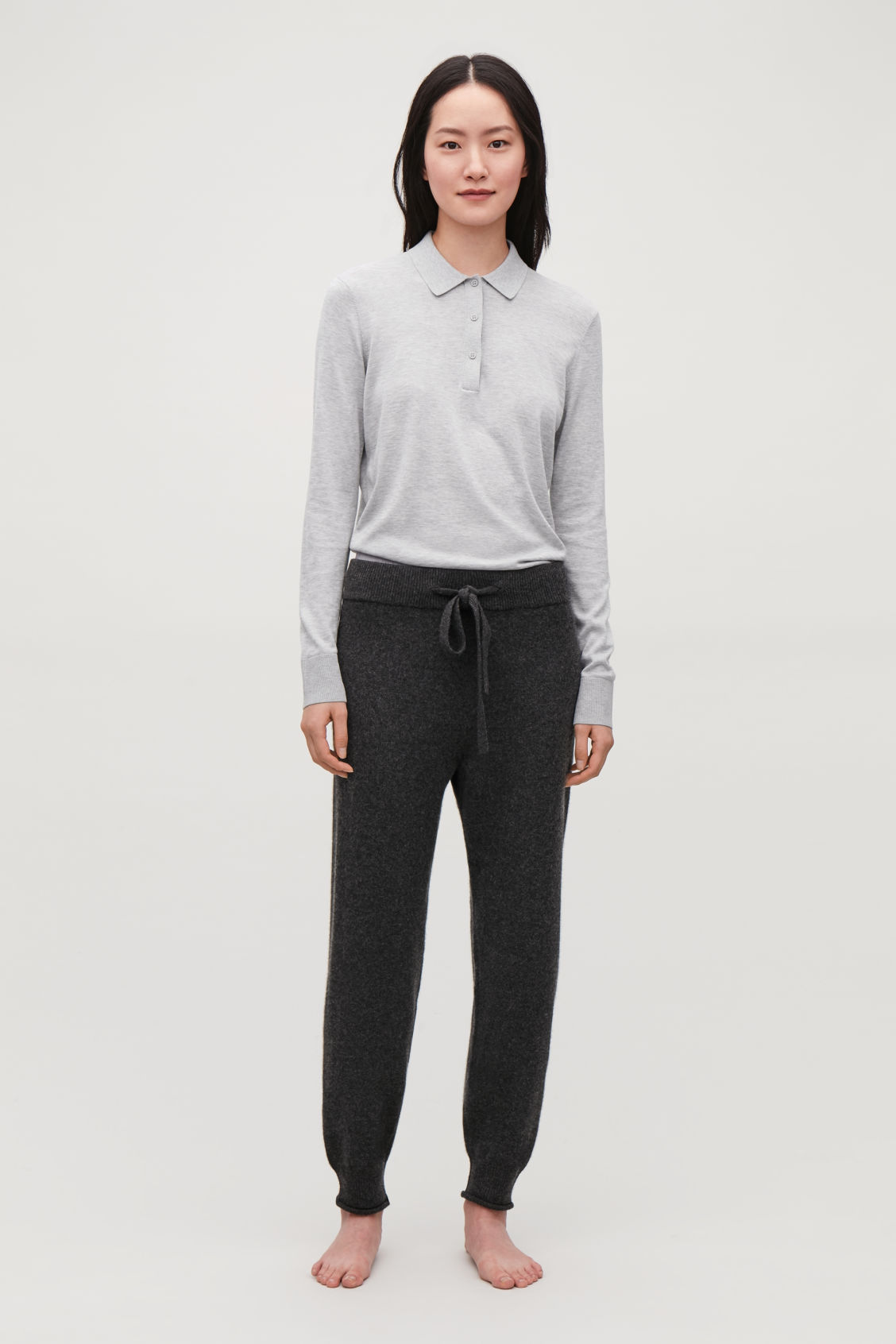 Detailed image of Cos cashmere drawstring trousers in grey