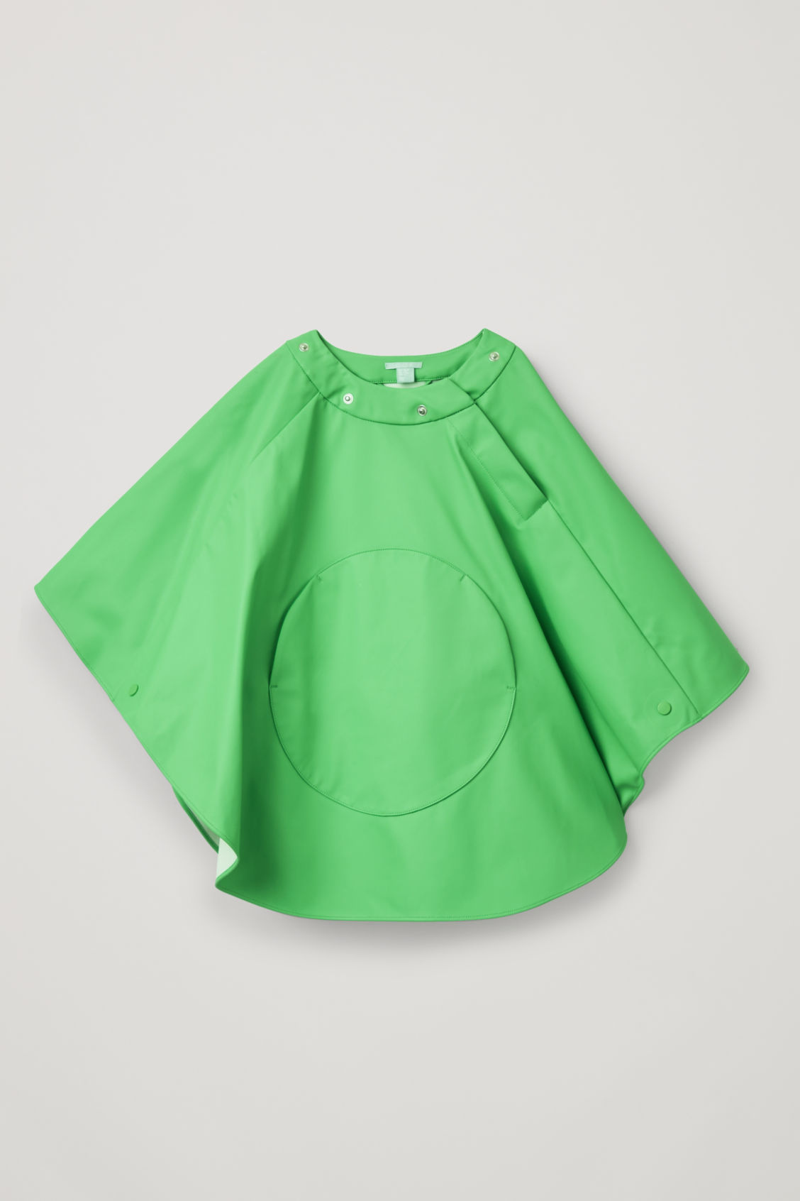 Detailed image of Cos raincoat with detachable hood in green