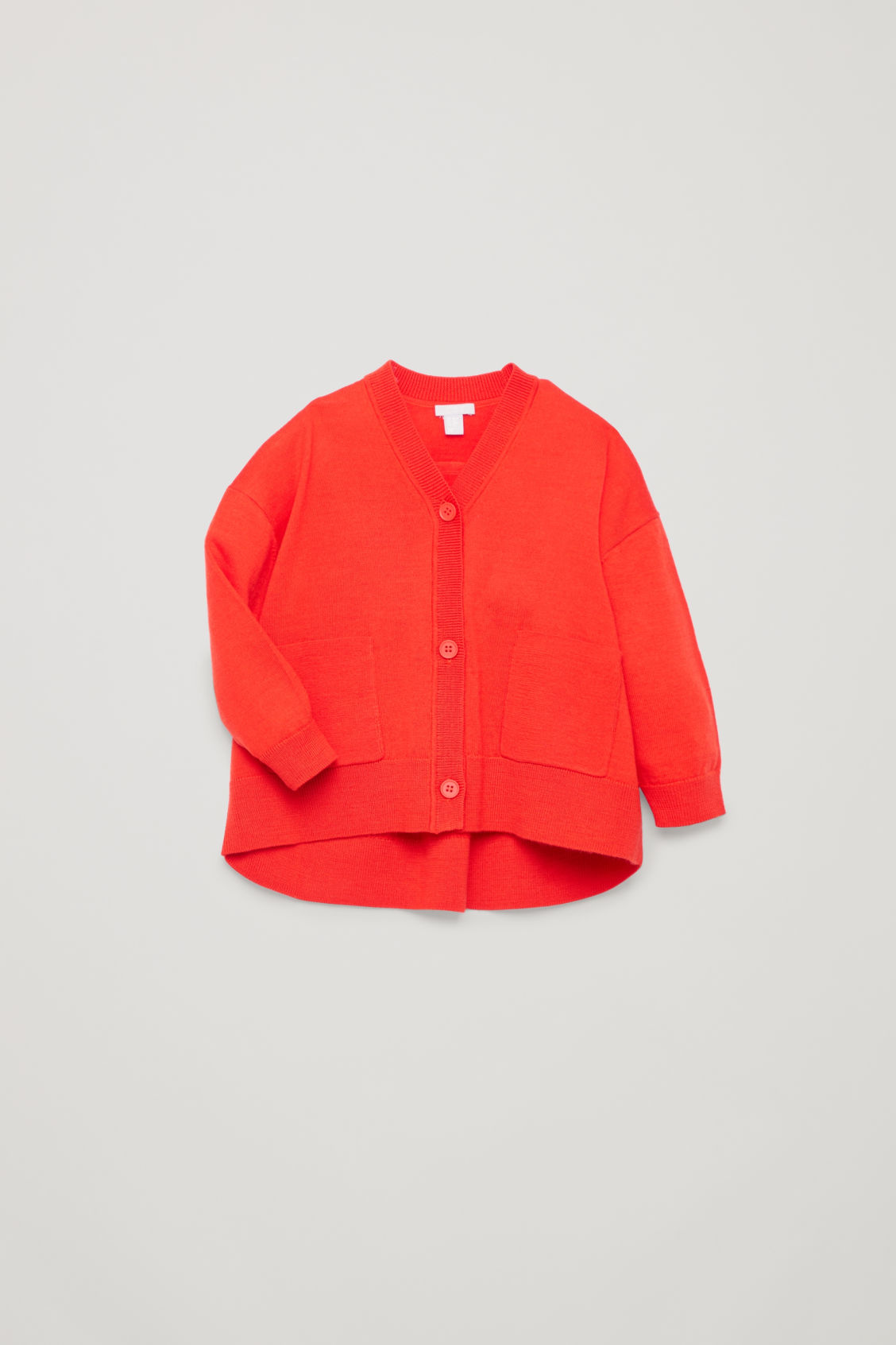Detailed image of Cos curved merino-wool cardigan in orange