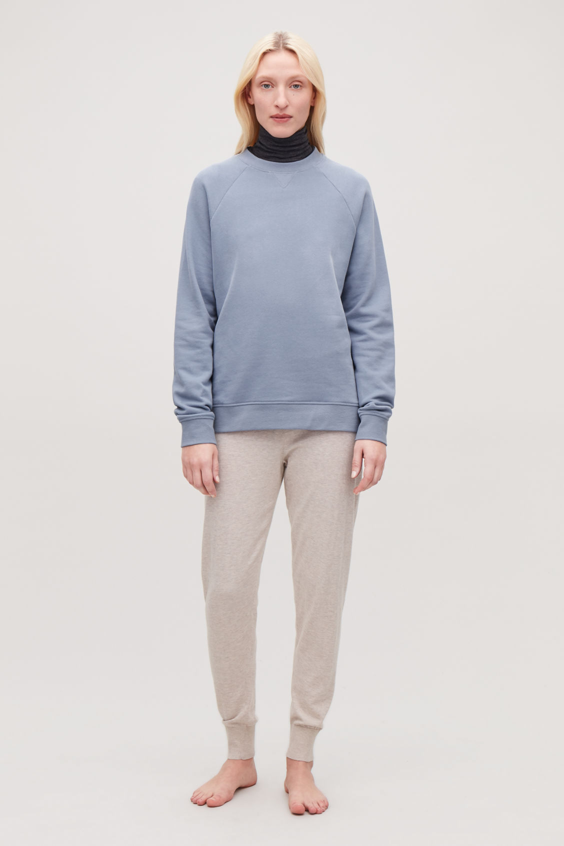 Detailed image of Cos relaxed jersey sweatshirt in blue