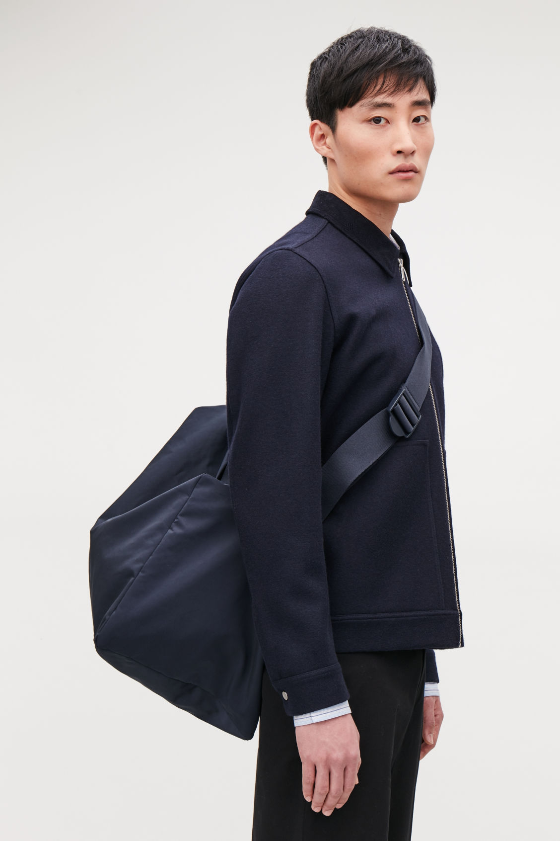 Detailed image of Cos collapsed technical holdall in blue