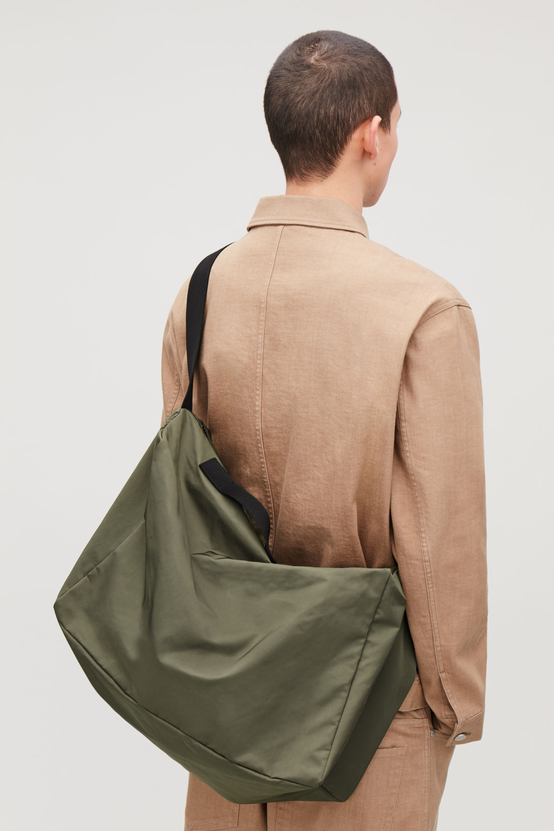Detailed image of Cos collapsed technical holdall in green