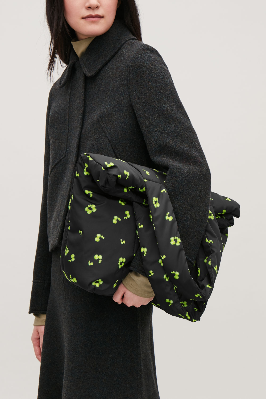 Detailed image of Cos glow-print padded tote bag in black