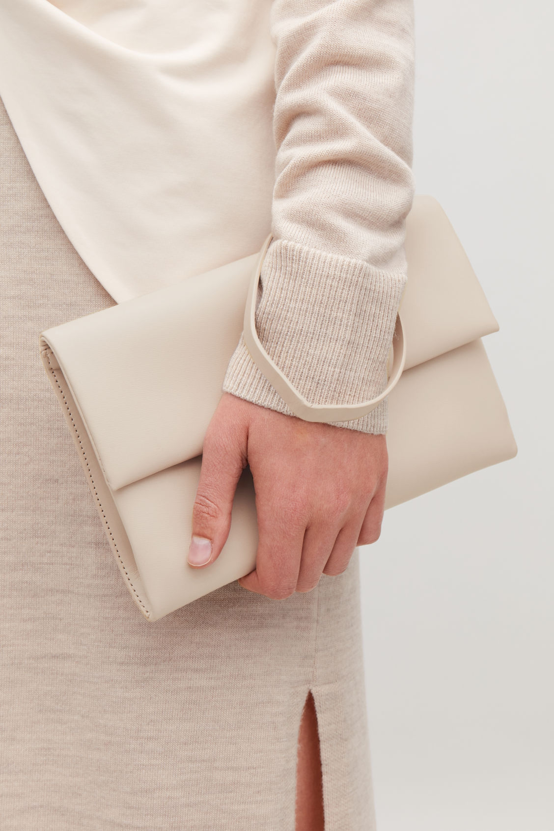 Detailed image of Cos leather clutch with card slots in beige