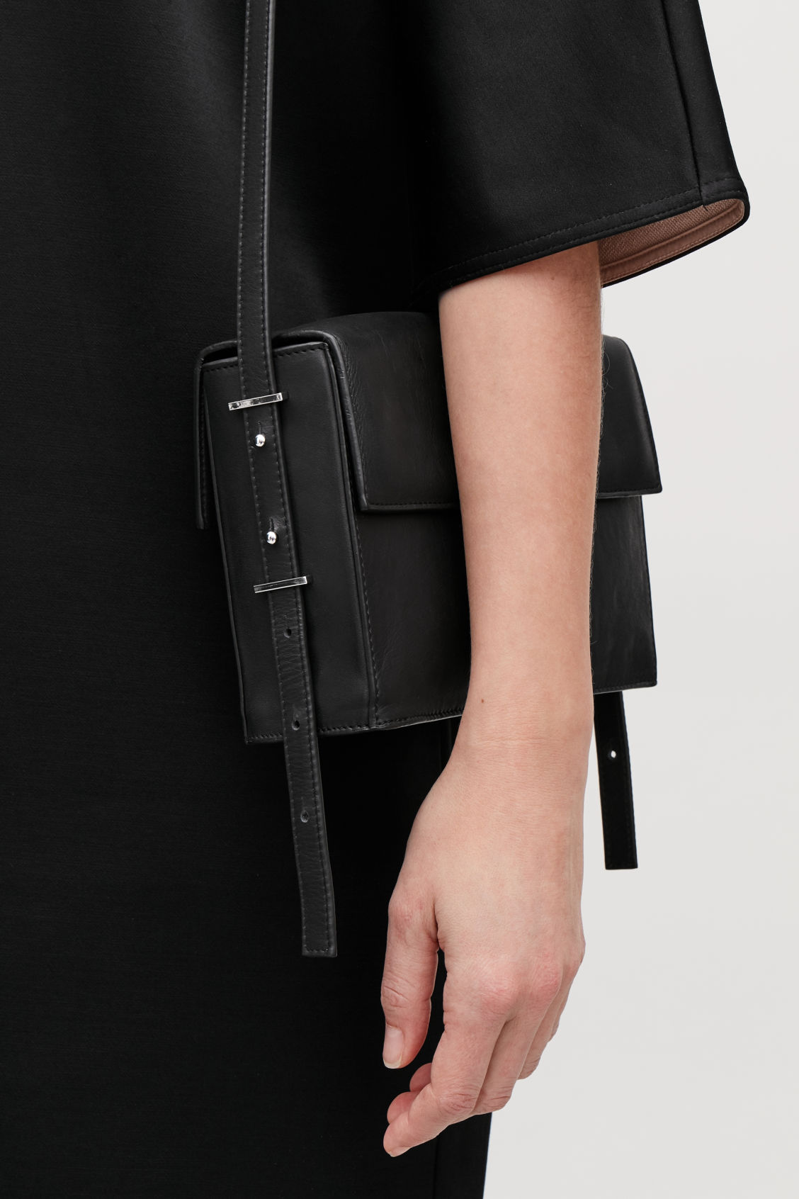 Detailed image of Cos double-flap box leather bag in black