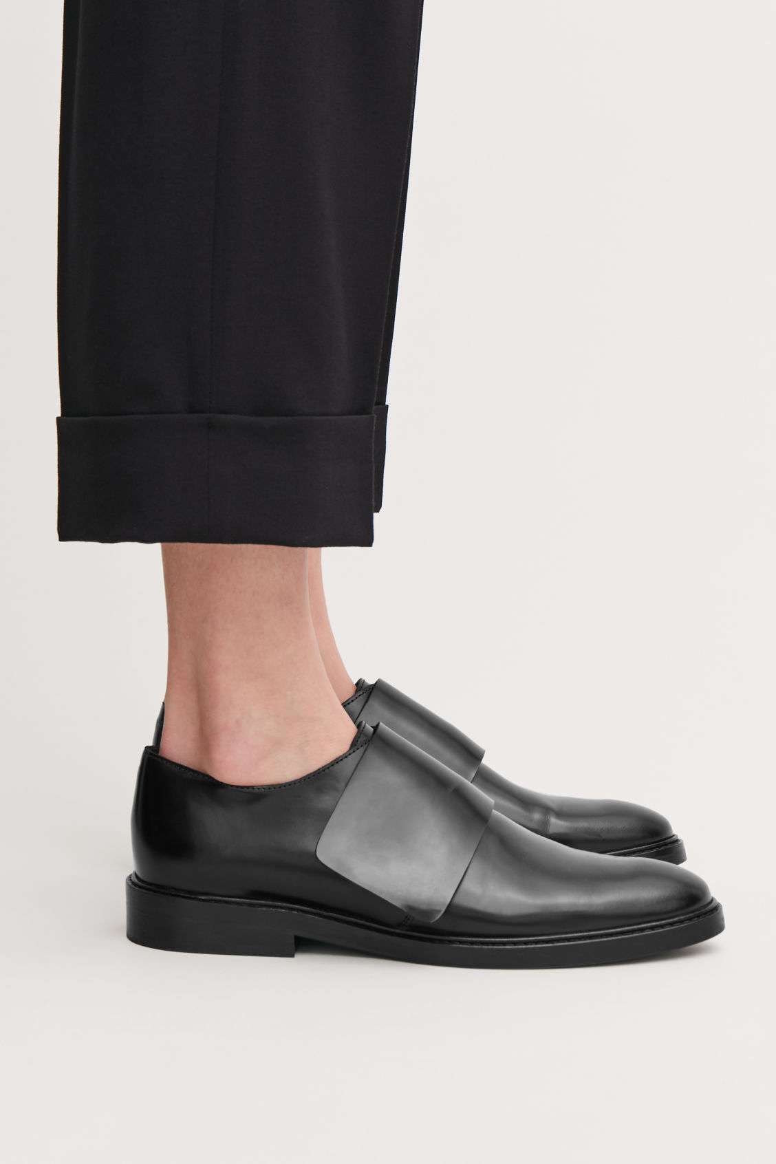 Detailed image of Cos wrap-over leather brogues  in black