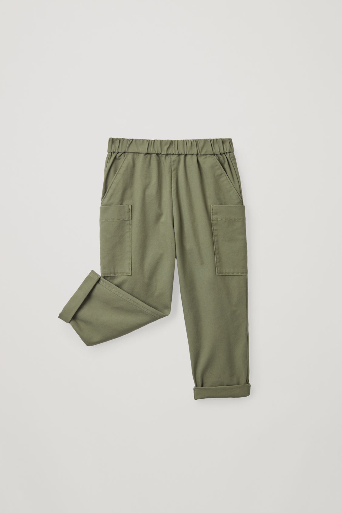 Detailed image of Cos cotton trousers with patch pockets  in green