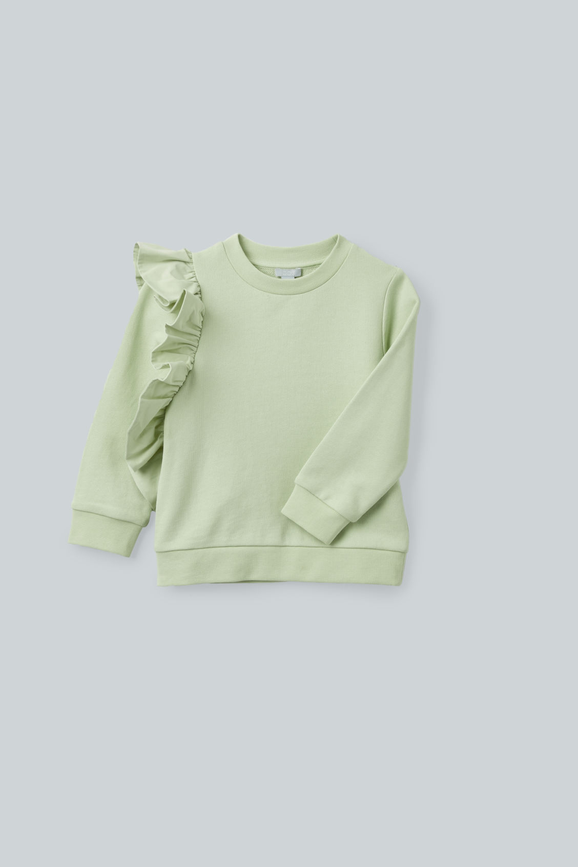 Detailed image of Cos frill-trimmed cotton sweatshirt  in green