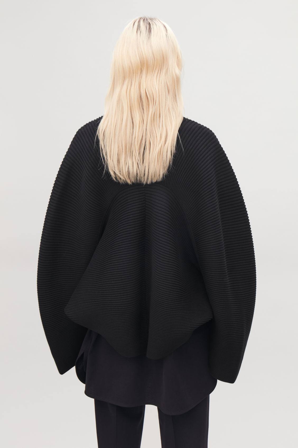 Detailed image of Cos cocoon ribbed cape in black