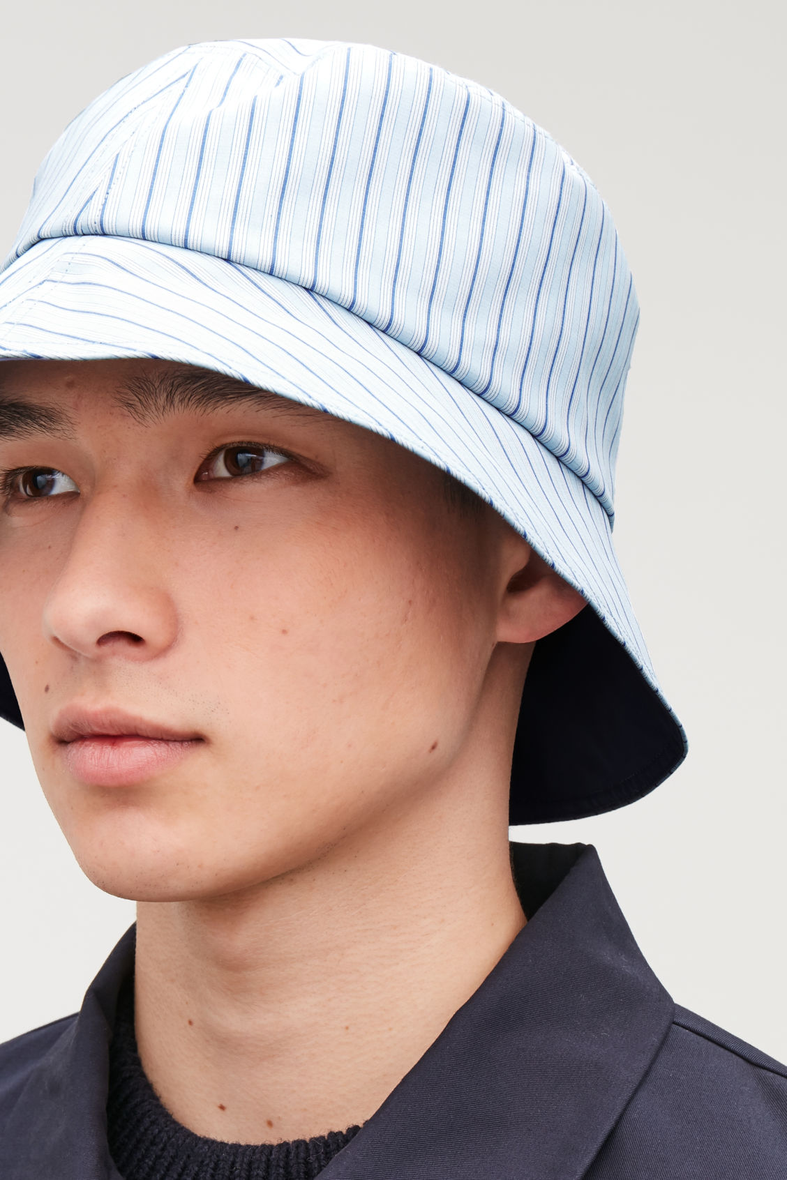 Detailed image of Cos striped bucket hat in blue