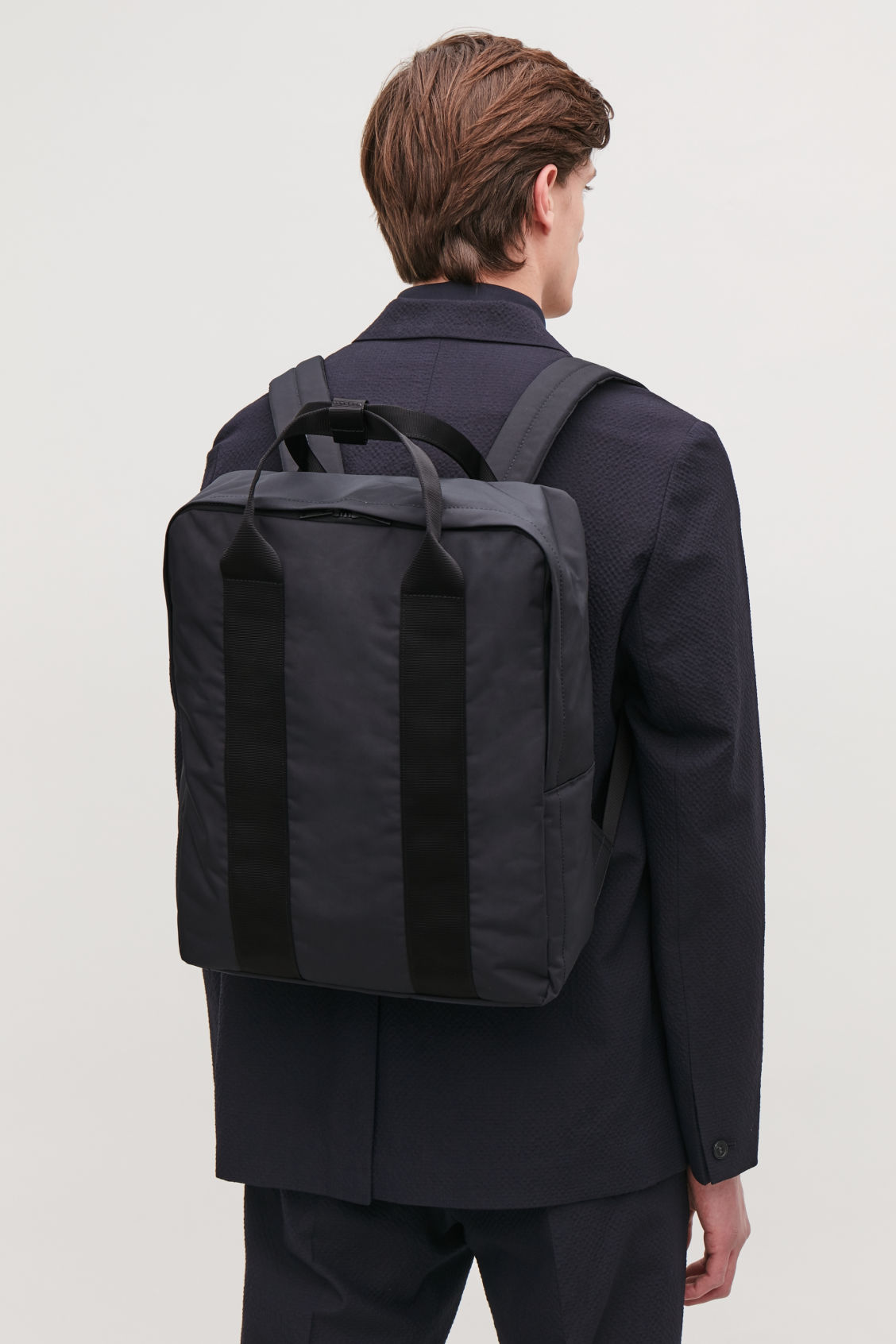 Detailed image of Cos technical tote backpack in blue