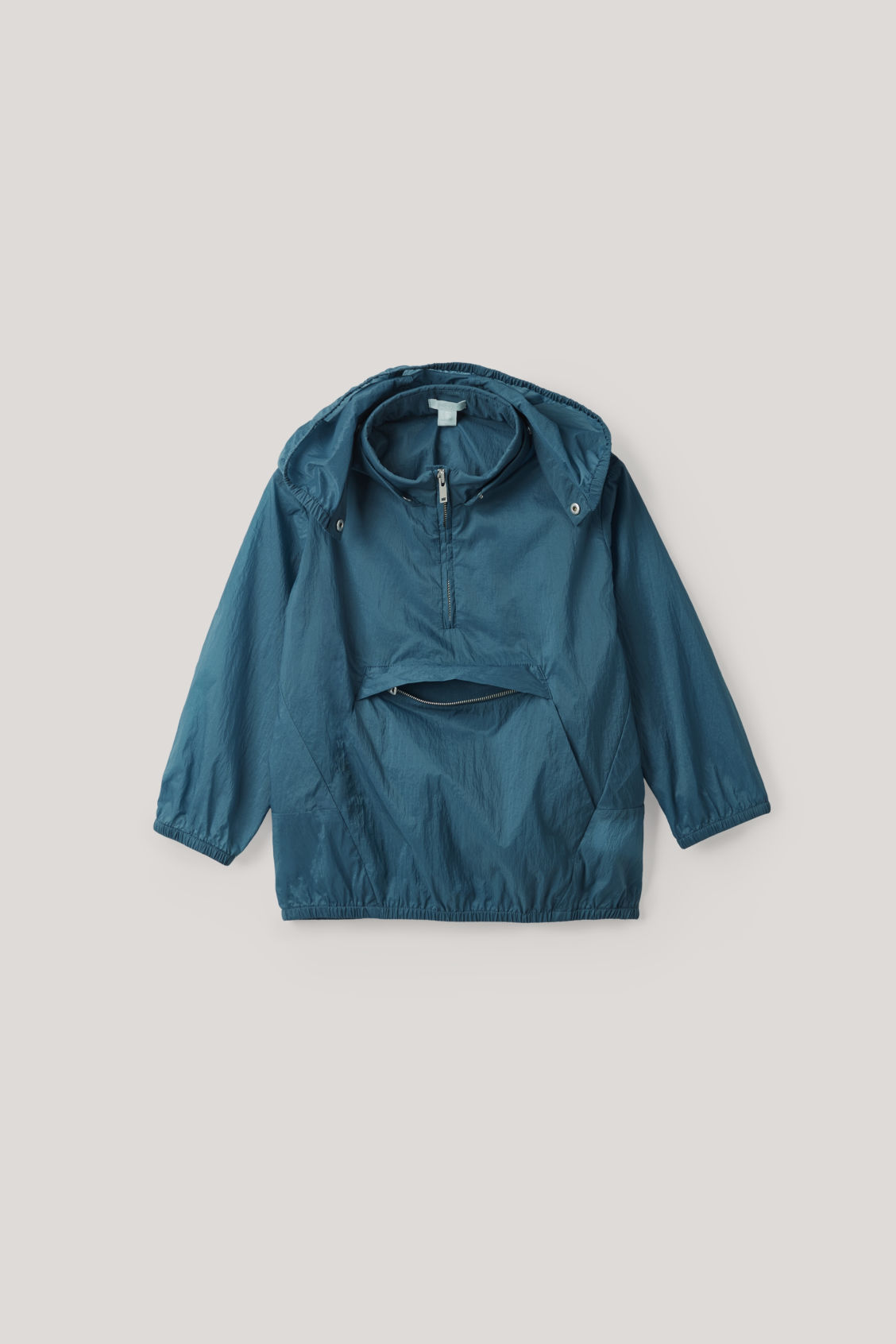 Detailed image of Cos packable lightweight jacket  in blue