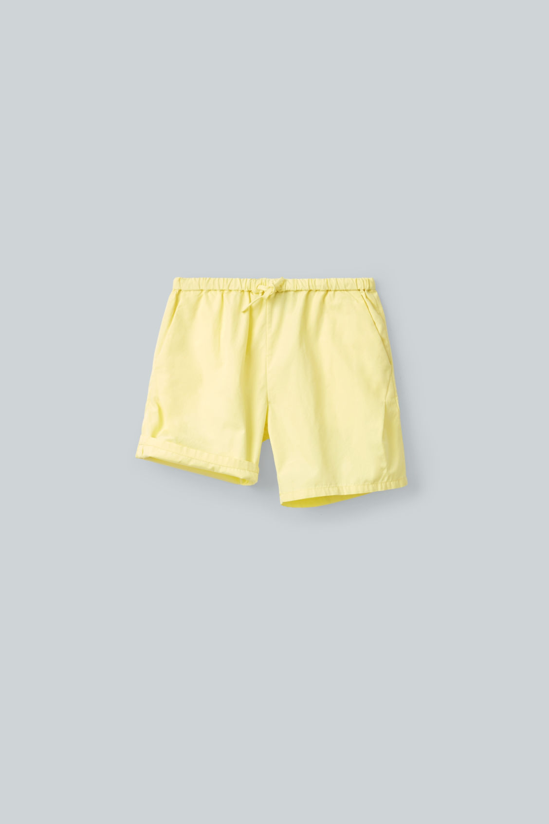 Detailed image of Cos drawstring cotton shorts in yellow