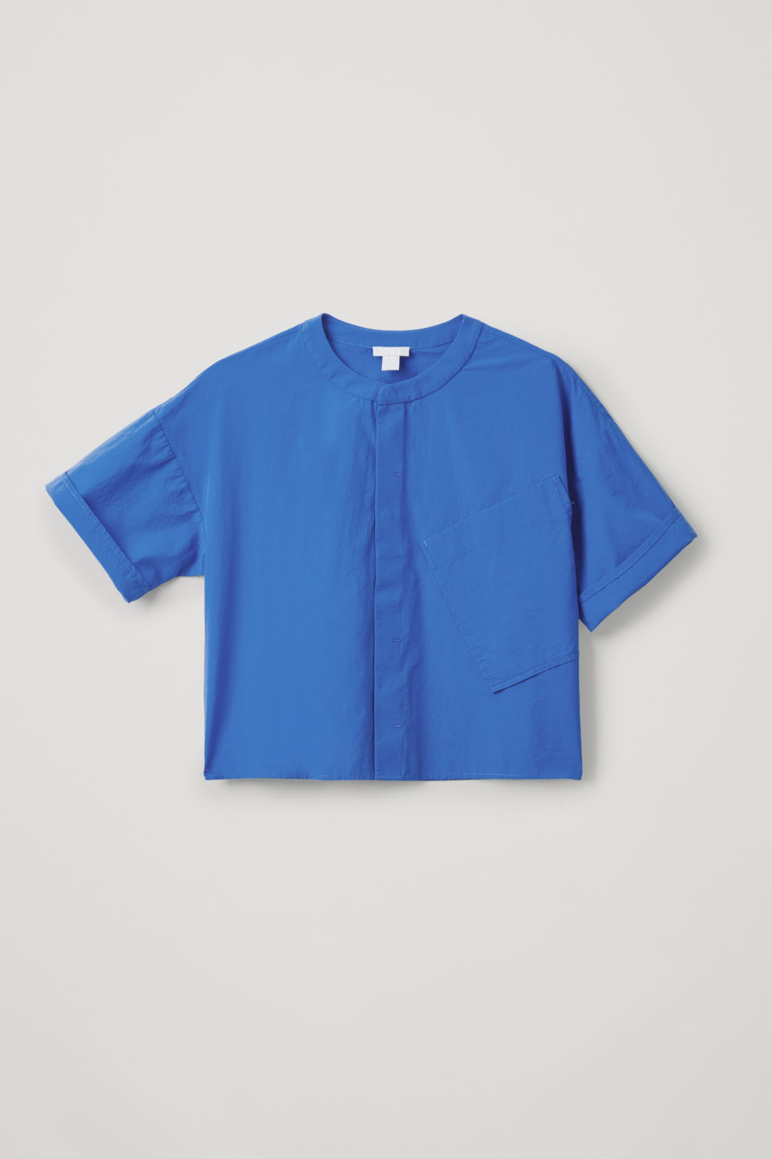 Detailed image of Cos relaxed shirt with slanted pocket  in blue