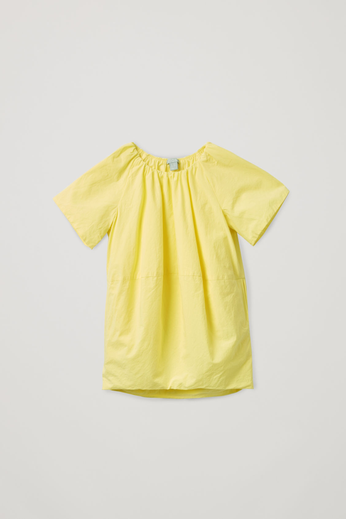 Detailed image of Cos voluminous-shape cotton dress in yellow