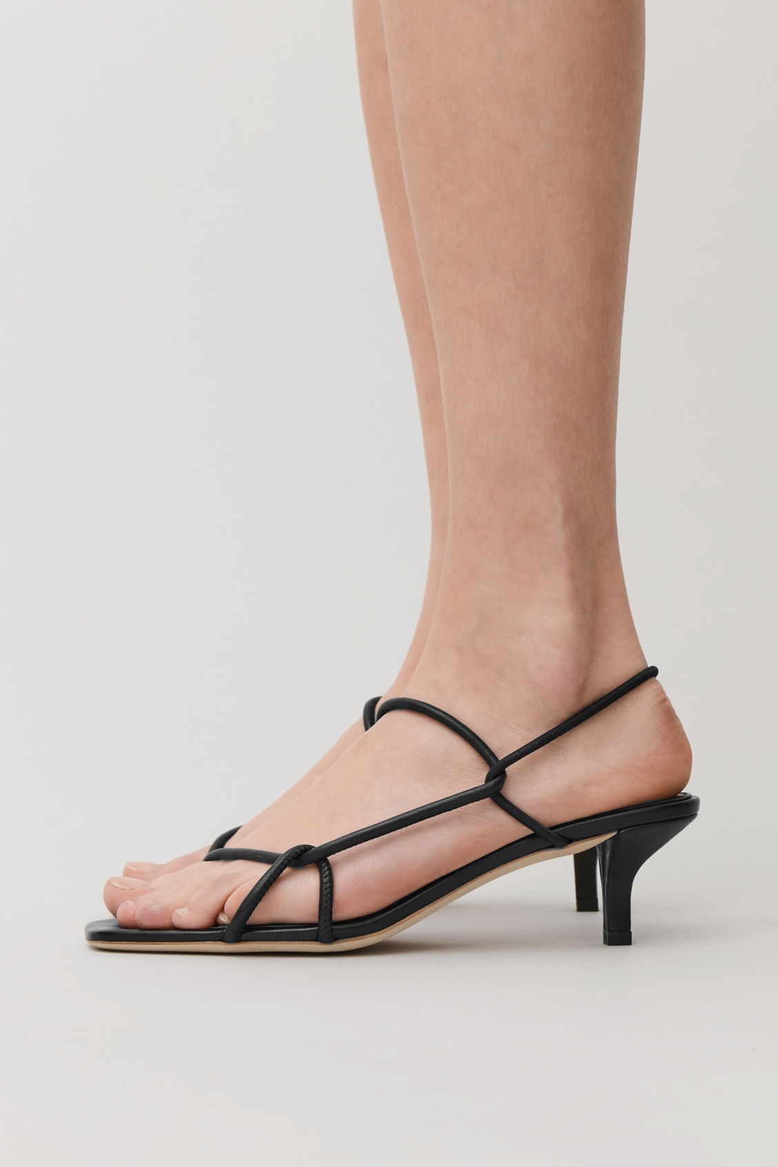 Detailed image of Cos strappy leather kitten-heel sandals in black